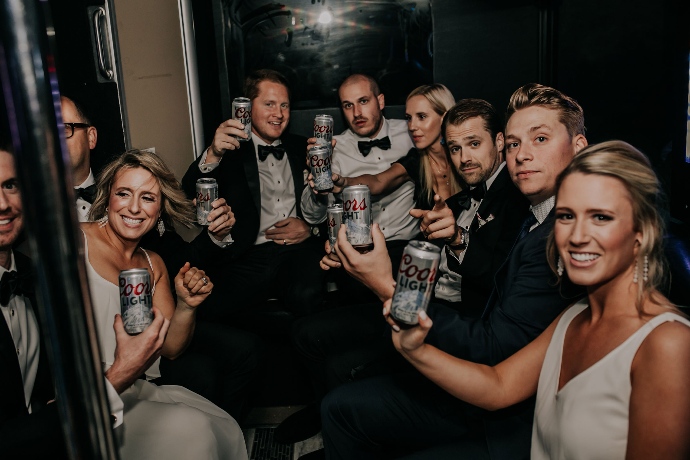 wedding-party-cheers-on-bus-omaha-nebraska-raelyn-ramey-photography.jpg