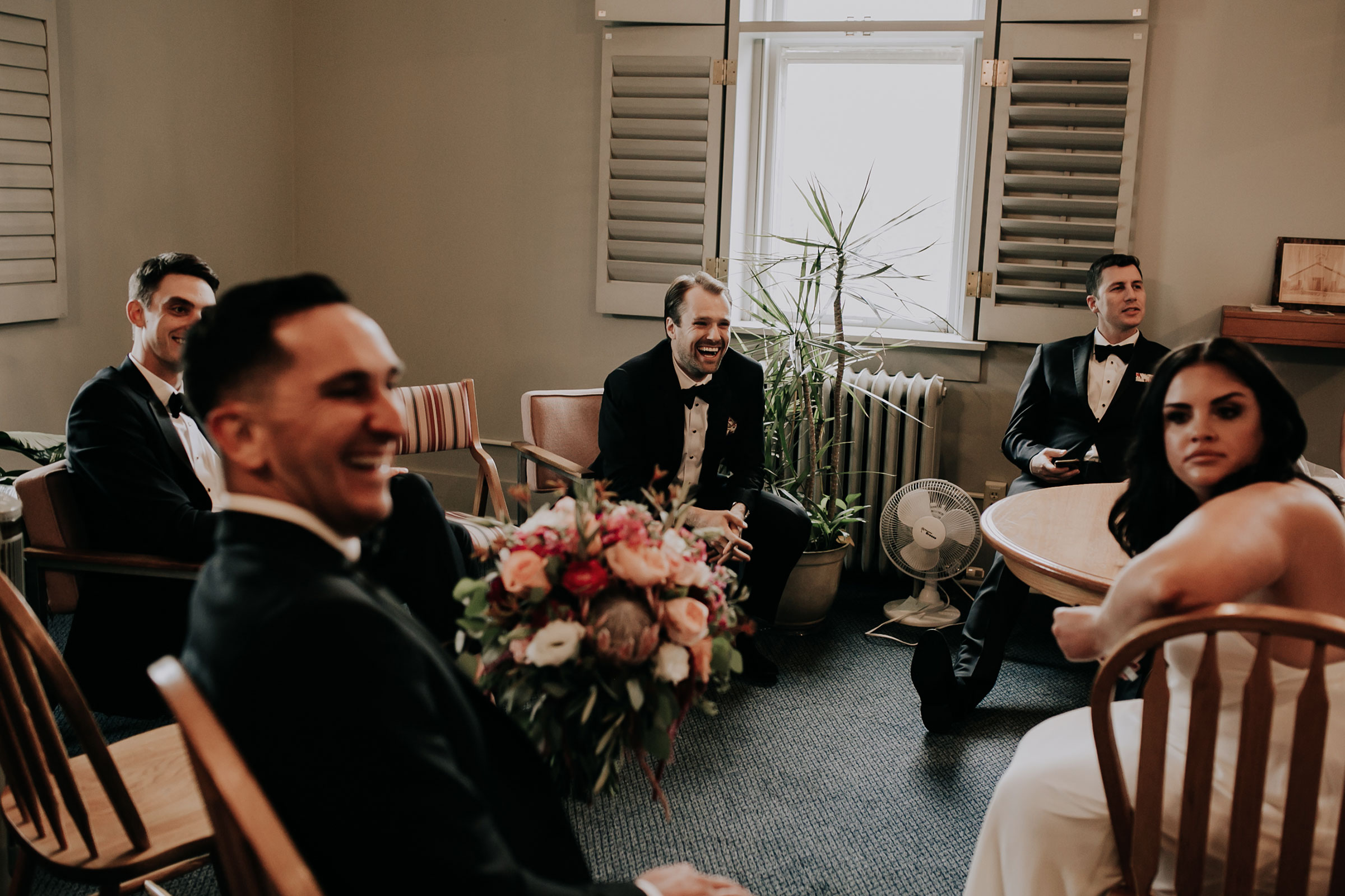 wedding-party-hanging-out-before-ceremony-st-johns-church-at-creighton-omaha-nebraska-raelyn-ramey-photography.jpg