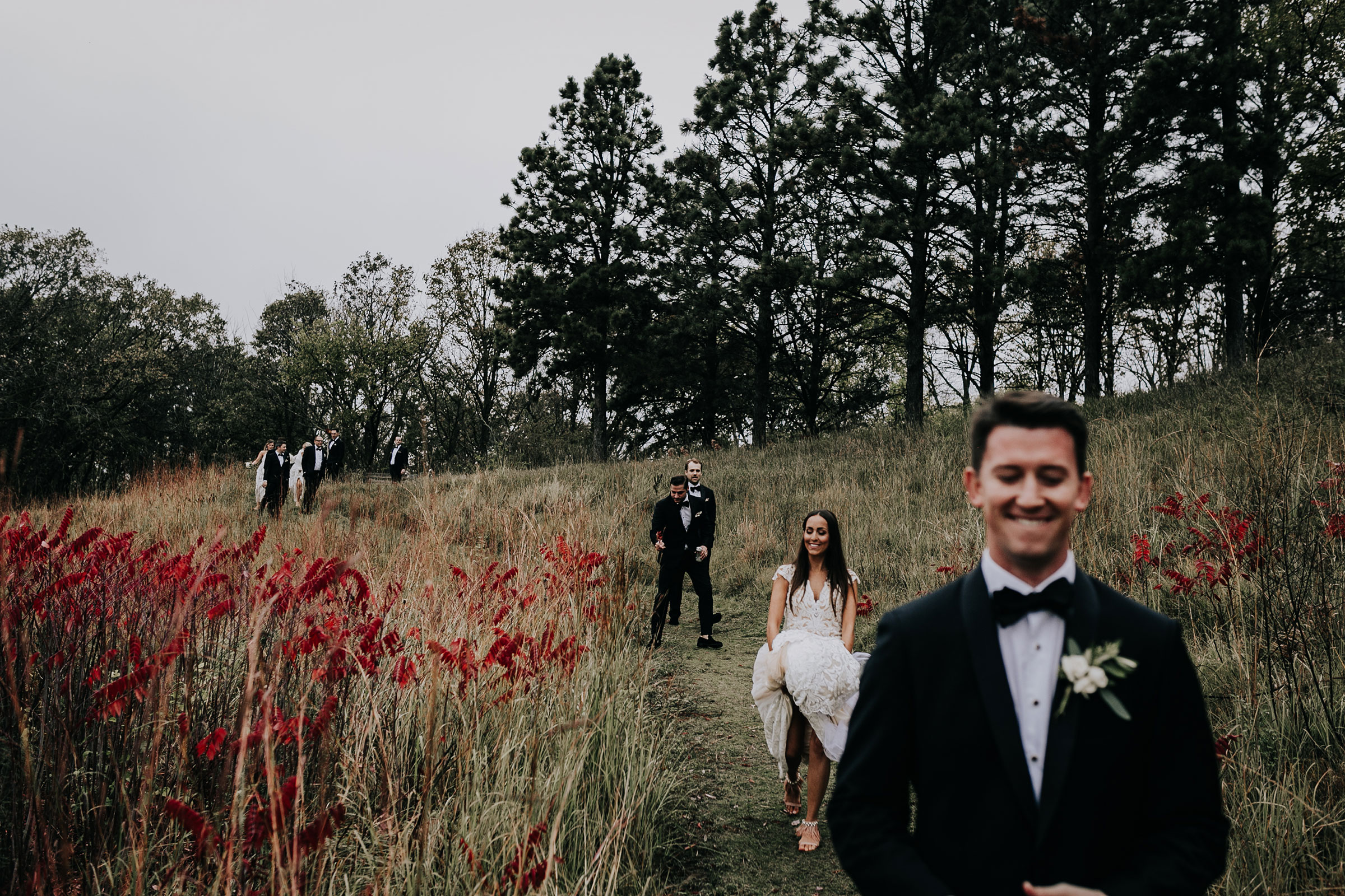 wedding-party-walking-down-hill-omaha-nebraska-raelyn-ramey-photography.jpg