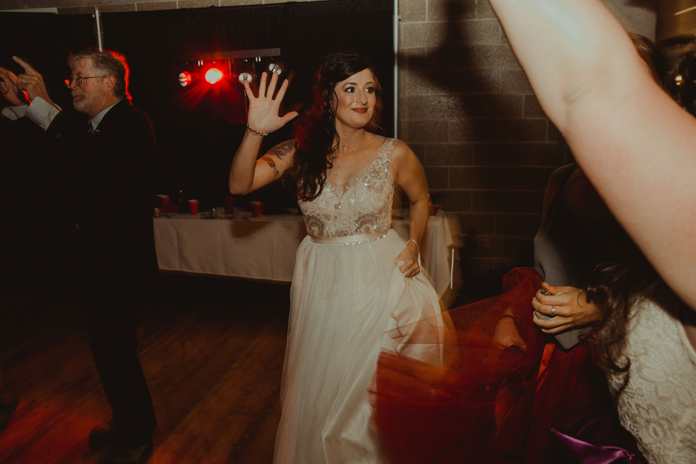 bride-dancing-at-reception-pella-plaza-desmoines-iowa-raelyn-ramey-photography.jpg
