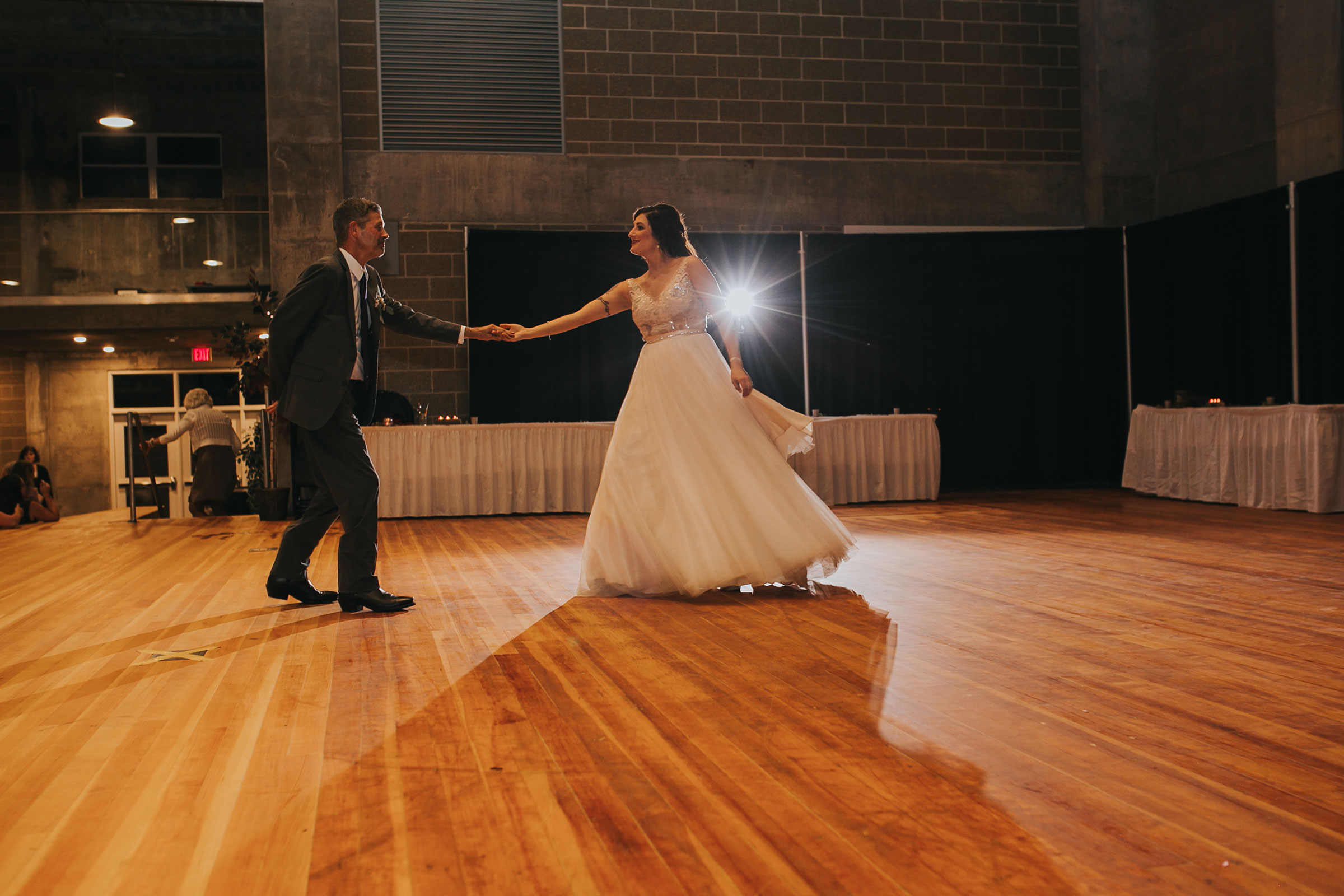 bride-first-dance-with-father-at-reception-pella-plaza-desmoines-iowa-raelyn-ramey-photography.jpg
