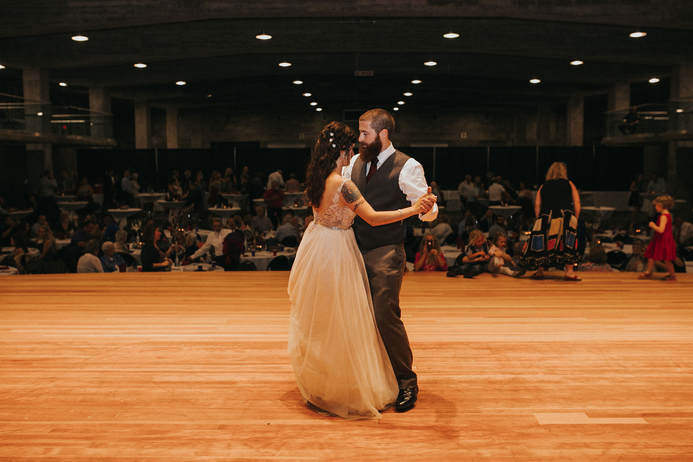 bride-groom-first-dance-at-reception-pella-plaza-desmoines-iowa-raelyn-ramey-photography.jpg