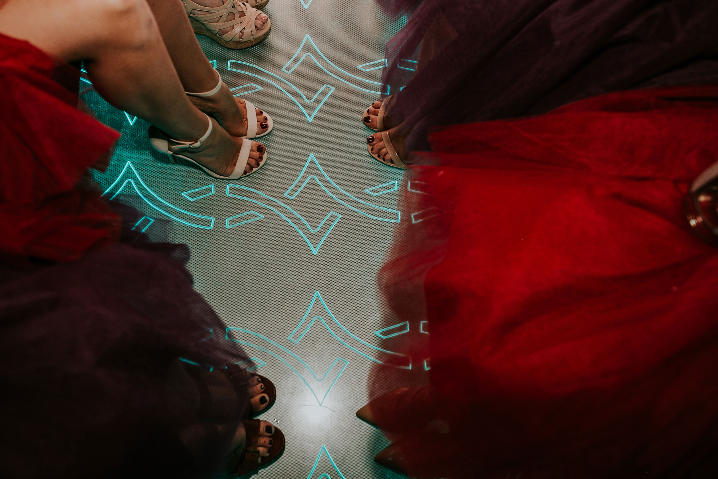 bridesmaids-shoes-on-bus-with-floor-lights-pella-plaza-desmoines-iowa-raelyn-ramey-photography.jpg