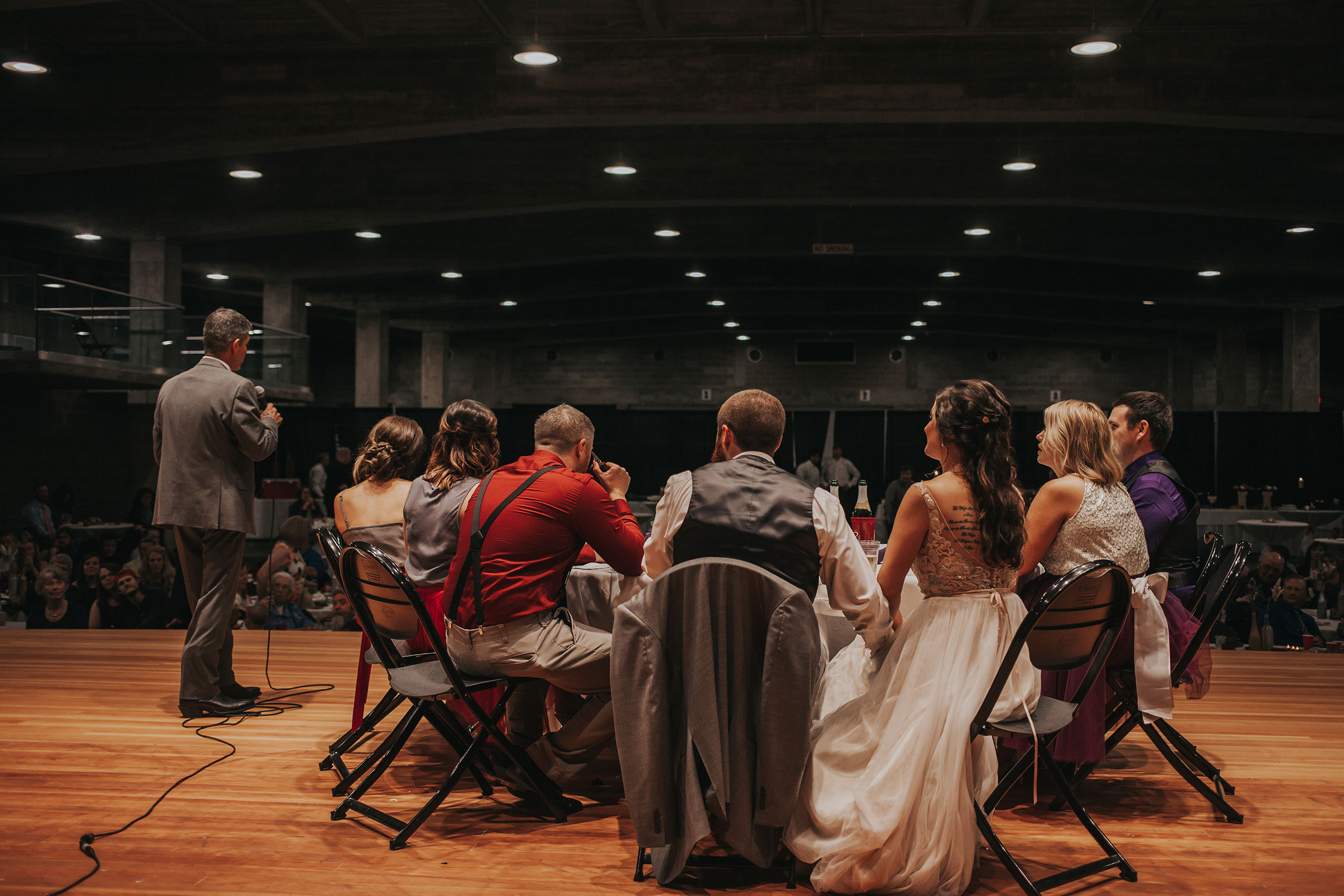 father-of-bride-telling-speech-pella-plaza-desmoines-iowa-raelyn-ramey-photography.jpg