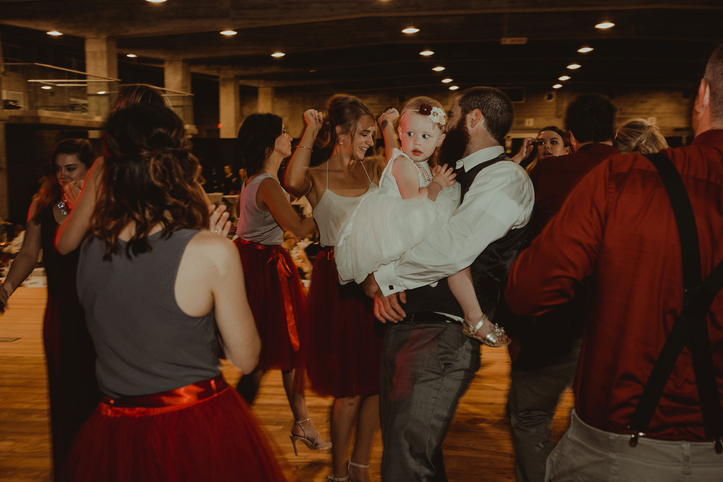 groom-dancing-with-flower-girl-at-reception-pella-plaza-desmoines-iowa-raelyn-ramey-photography.jpg