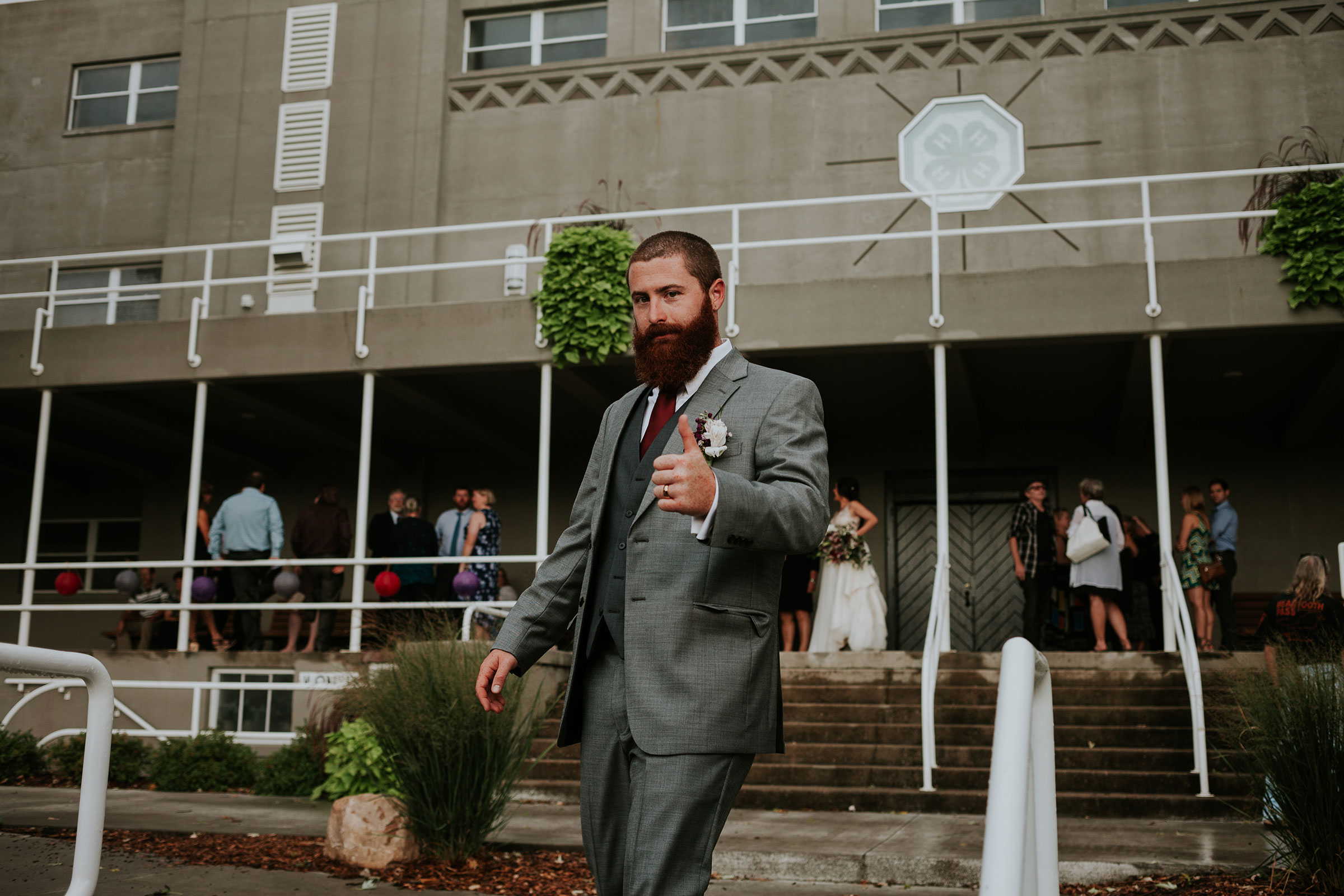 groom-thumbs-up-getting-on-party-bus-iowa-state-fairgrounds-desmoines-iowa-raelyn-ramey-photography.jpg