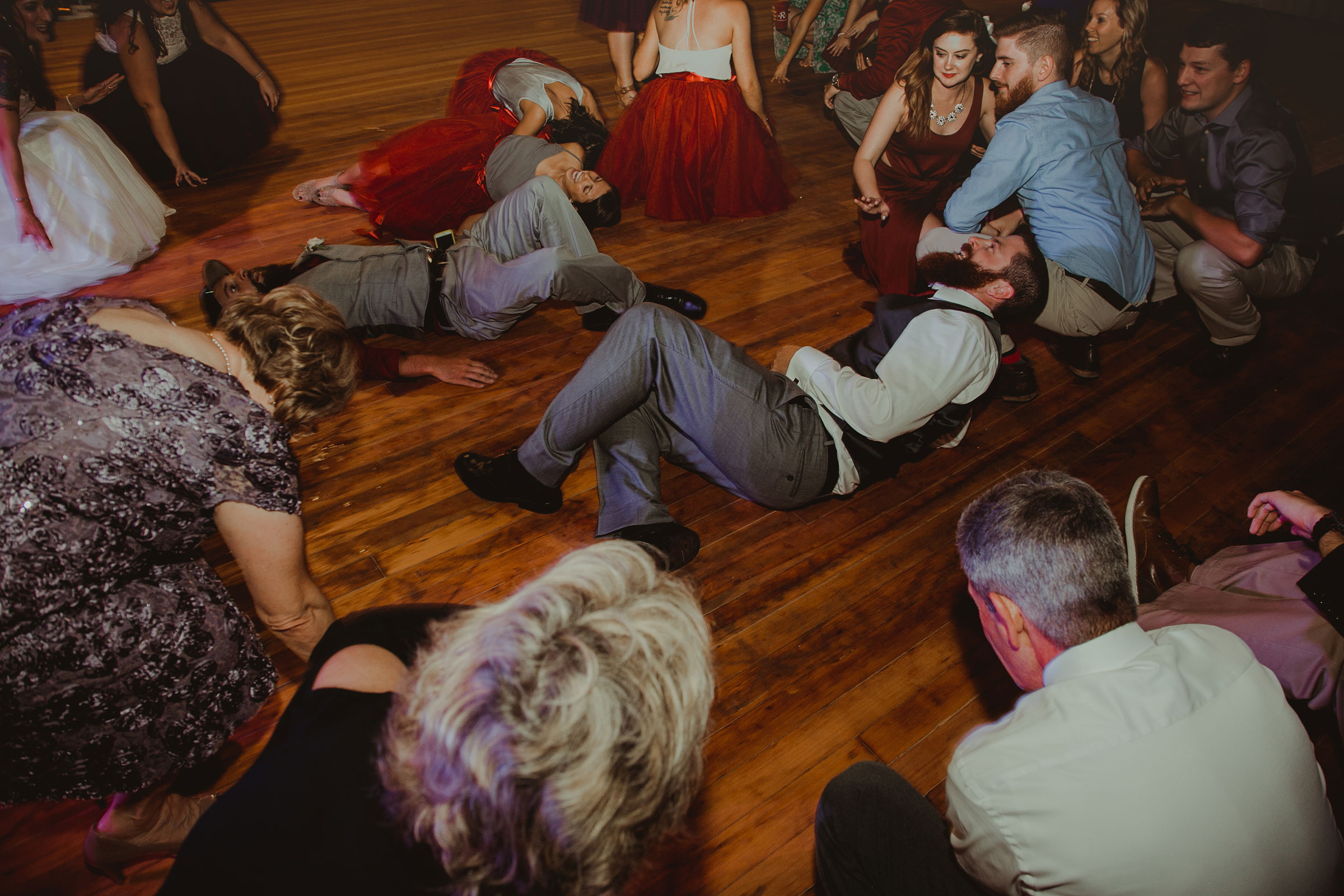 guest-and-wedding-party-dancing-at-reception-pella-plaza-desmoines-iowa-raelyn-ramey-photography.jpg