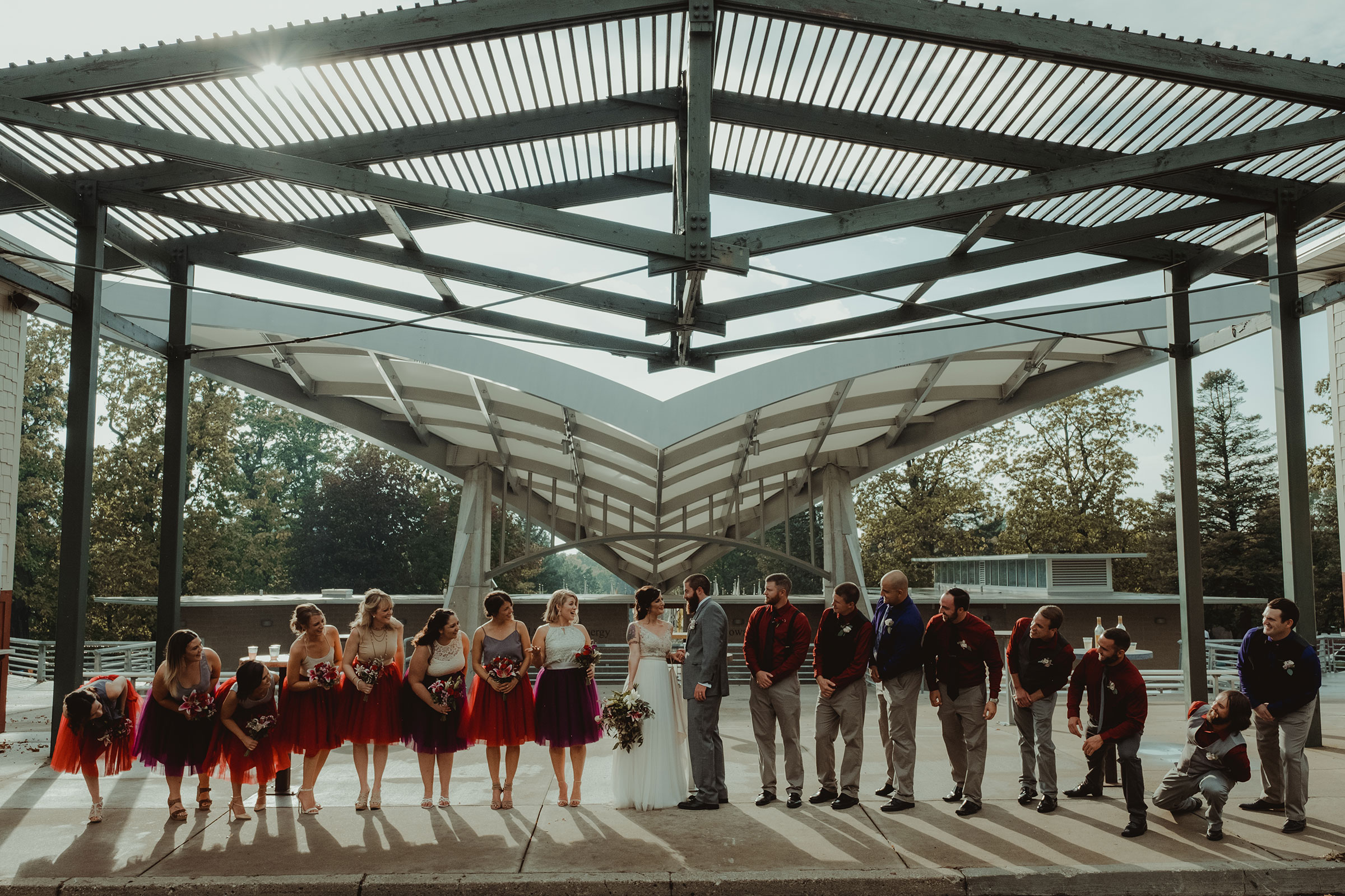 wedding-party-lined-up-under-band-shell-iowa-state-fairgrounds-desmoines-iowa-raelyn-ramey-photography.jpg