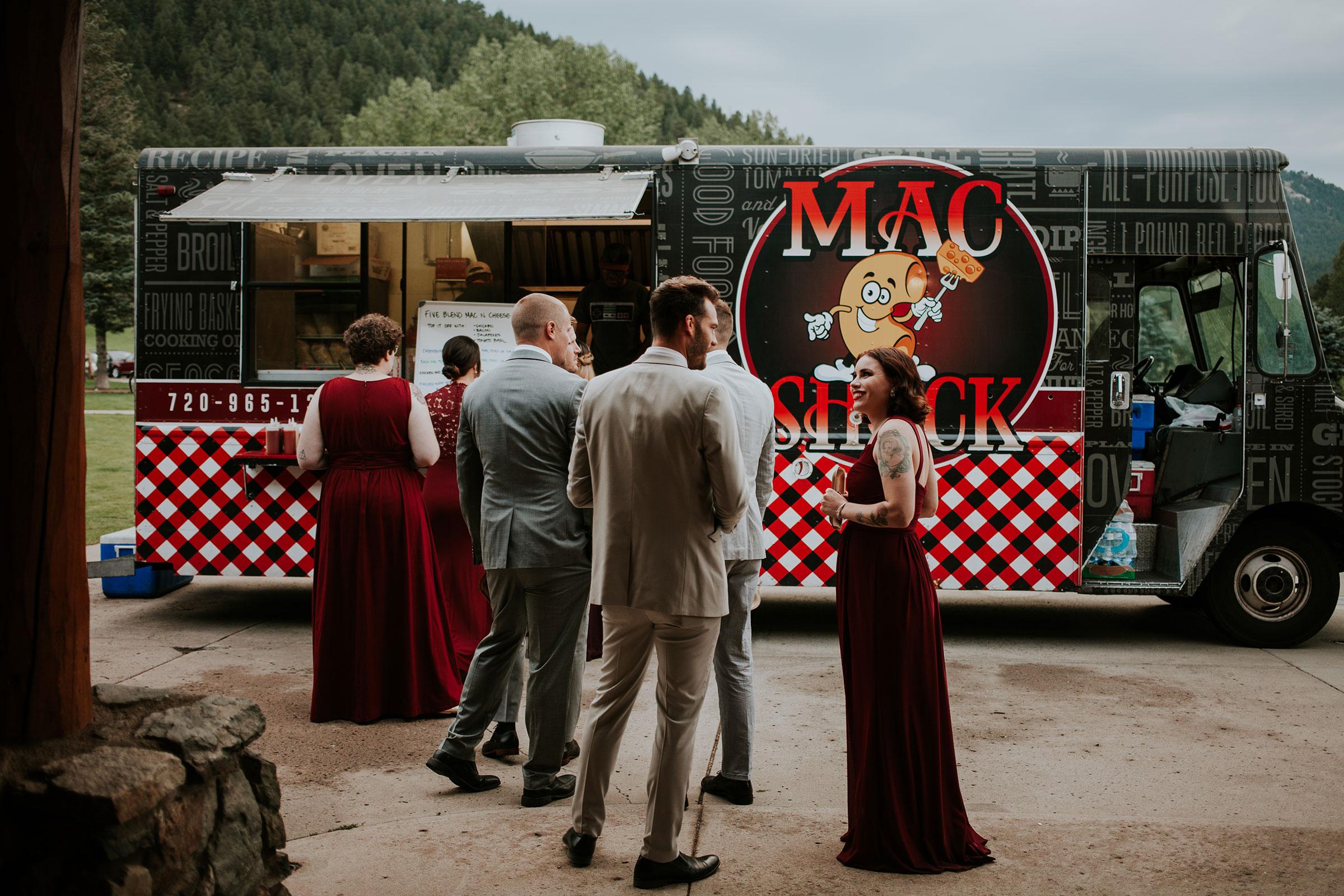 guest-getting-food-at-mac-shack-food-truck-evergreen-lake-colorado-raelyn-ramey-photography.jpg