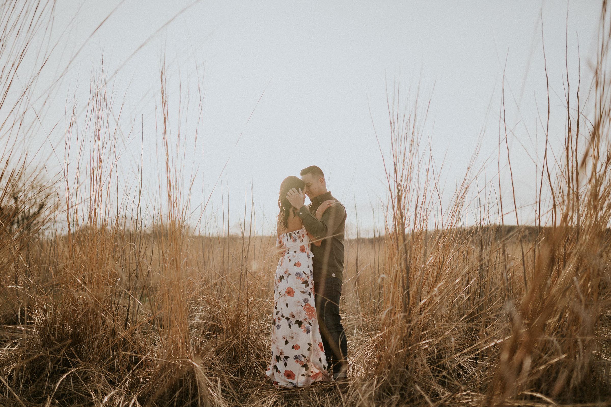 couple-holding-each-other-in-field-winterset-iowa-raelyn-ramey-photography.jpg