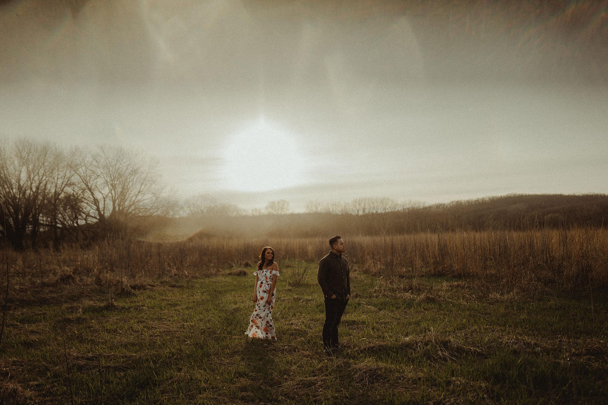 couple-standing-in-field-engagement-winterset-iowa-raelyn-ramey-photography.jpg