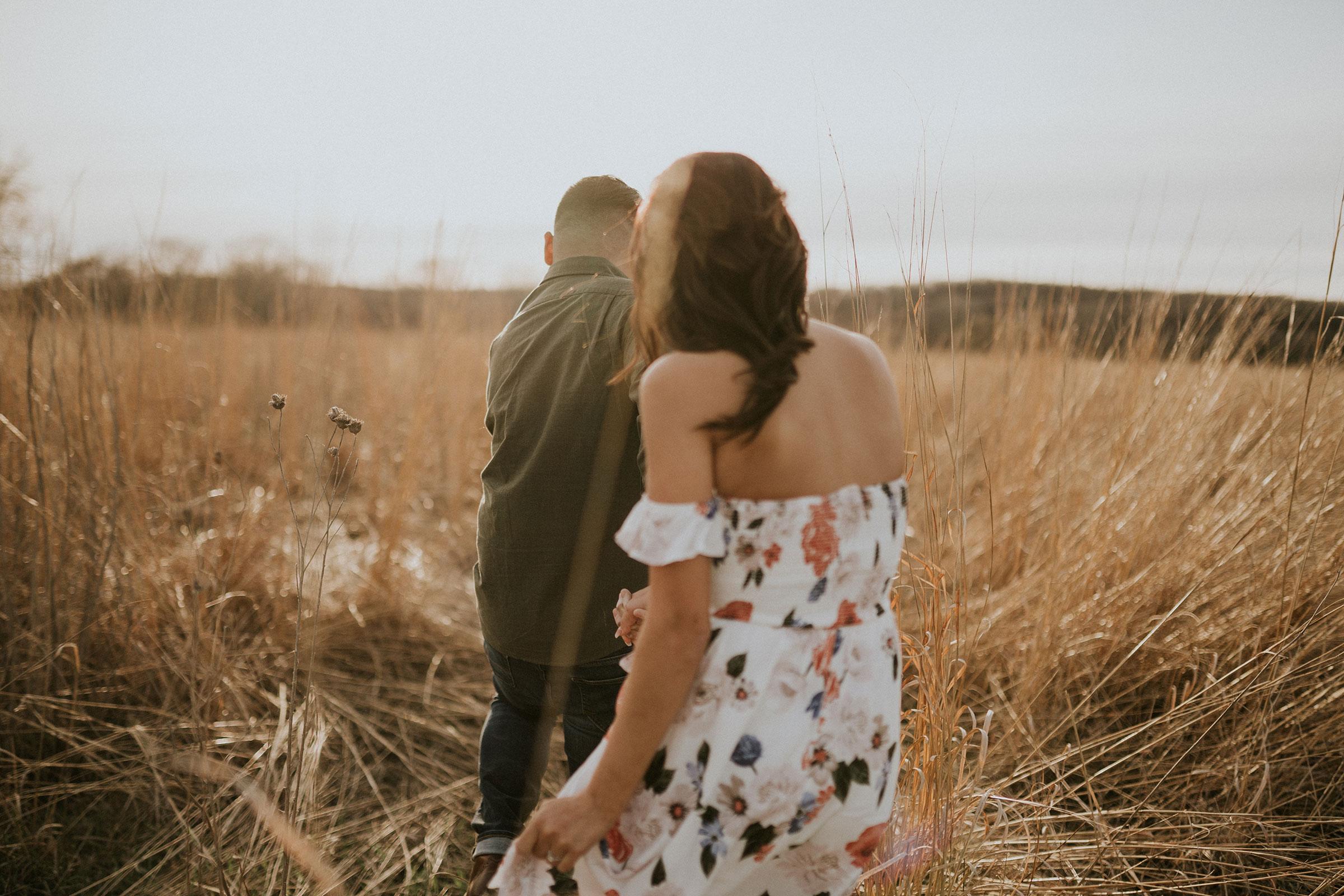 couple-walking-into-field-winterset-iowa-raelyn-ramey-photography.jpg