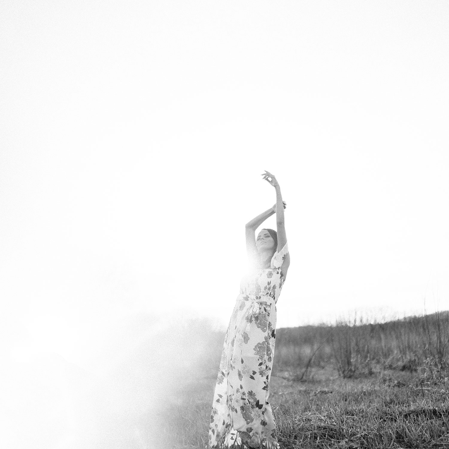 woman-standing-in-field-with-arms-in-the-air-winterset-iowa-raelyn-ramey-photography.jpg