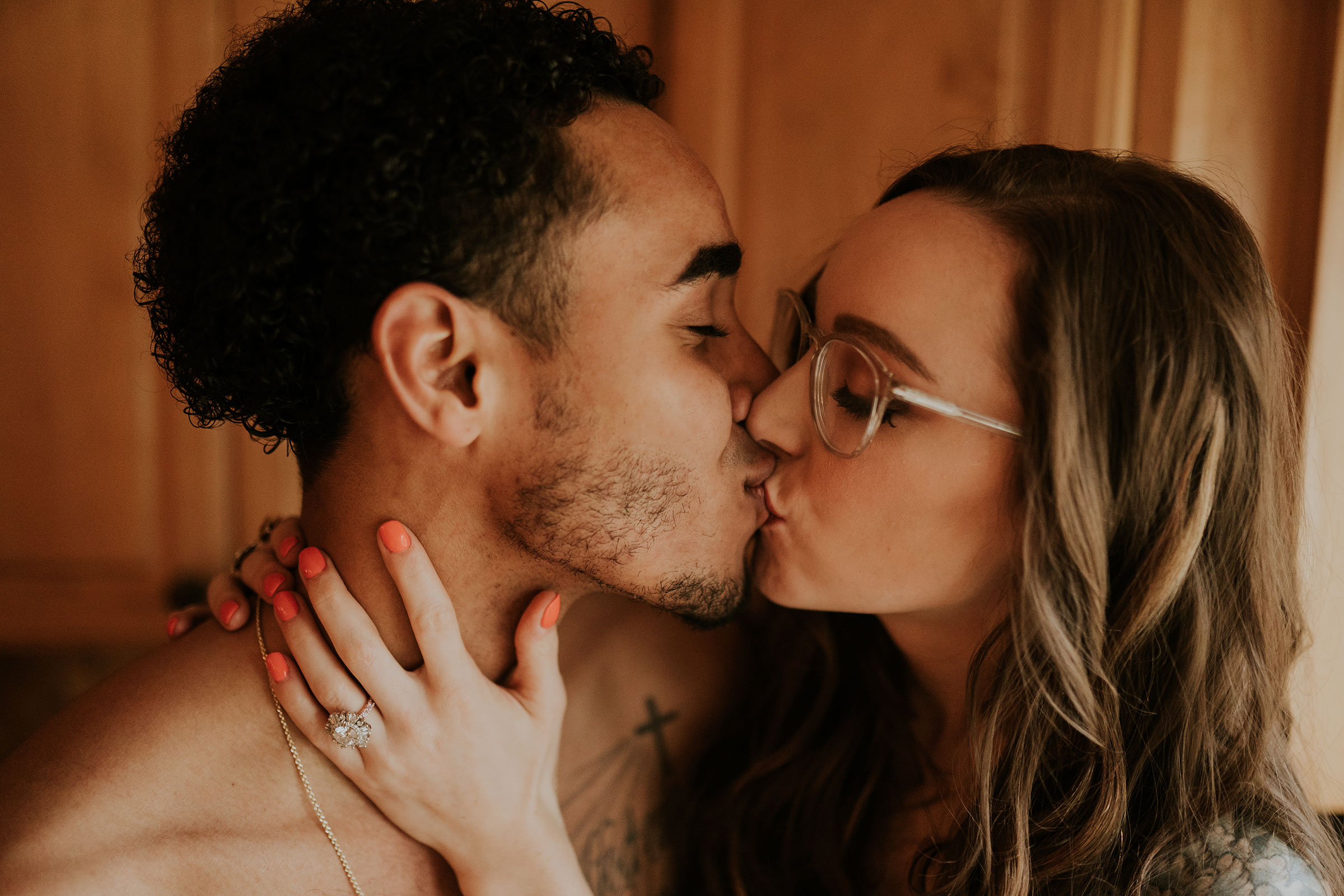 couple-kissing-in-kitchen-engagement-desmoines-iowa-raelyn-ramey-photography.jpg