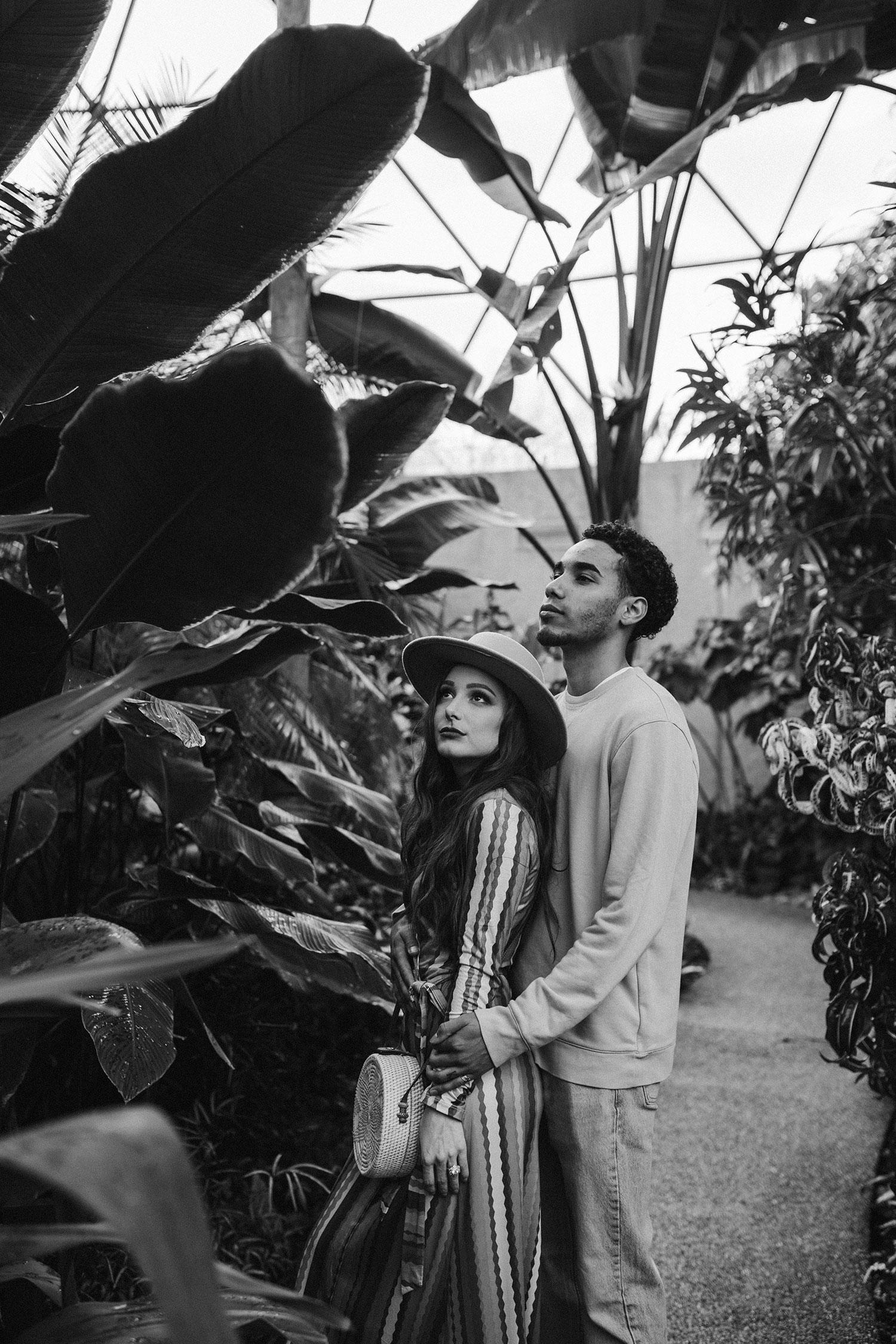couple-standing-amongst-plants-botanical-gardens-engagement-desmoines-iowa-raelyn-ramey-photography.jpg