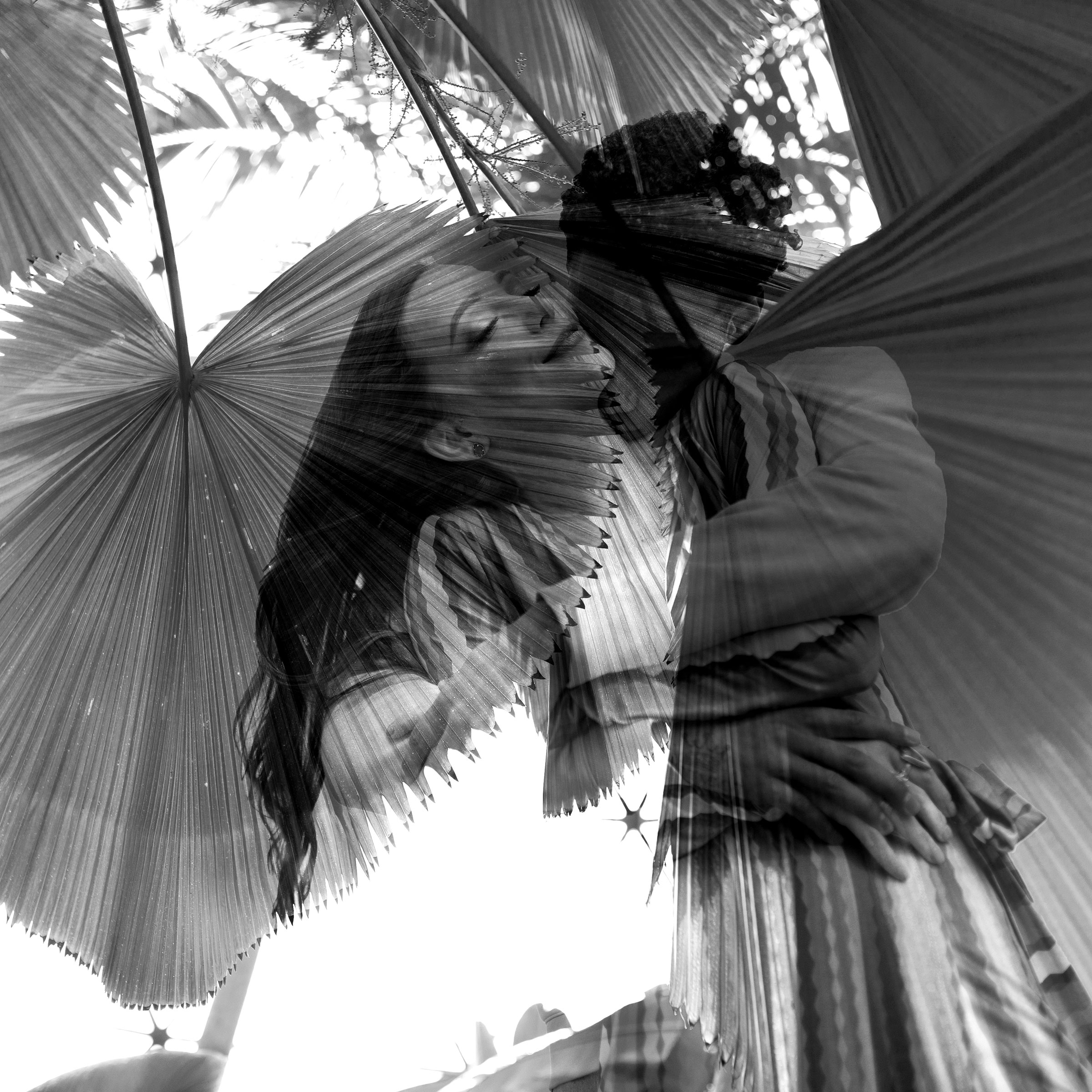 double-exposure-of-couple-hugging-in-leaves-engagement-desmoines-iowa-raelyn-ramey-photography.jpg
