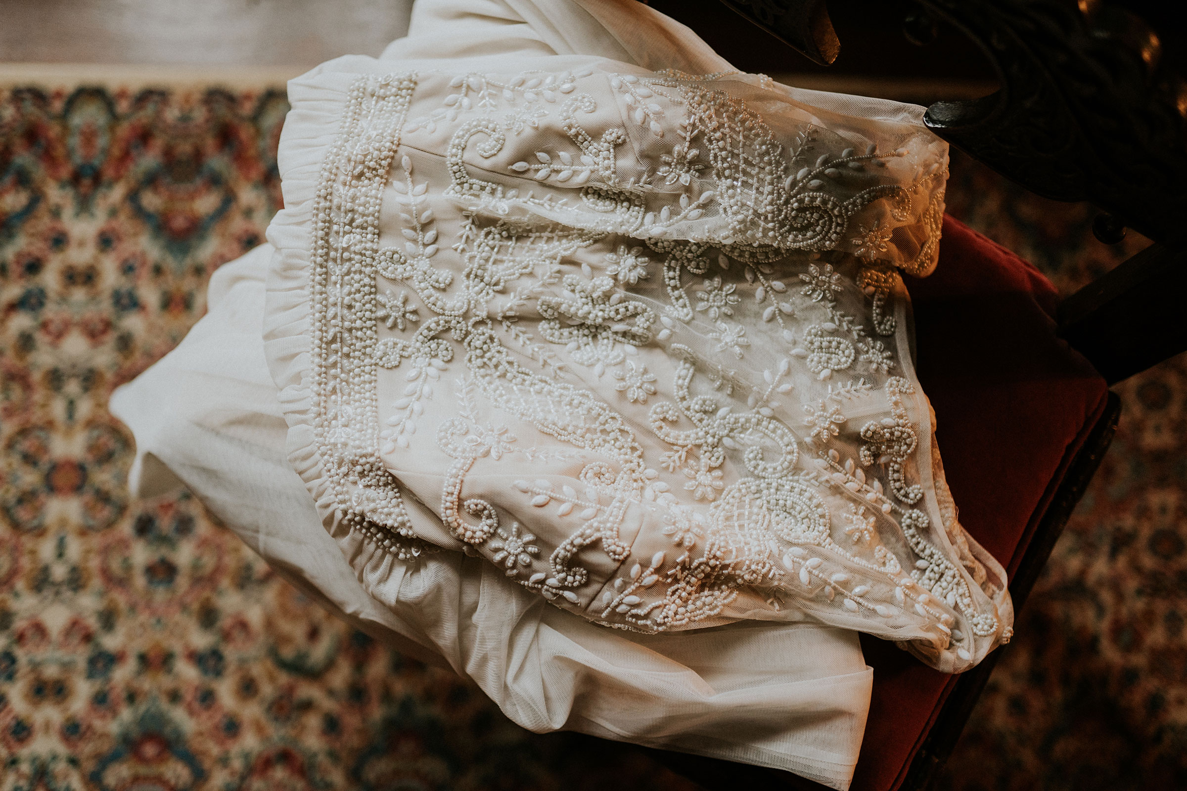 dress-detail-shot-laying-on-chair-elopement-salisbury-house-desmoines-iowa-raelyn-ramey-photography.jpg