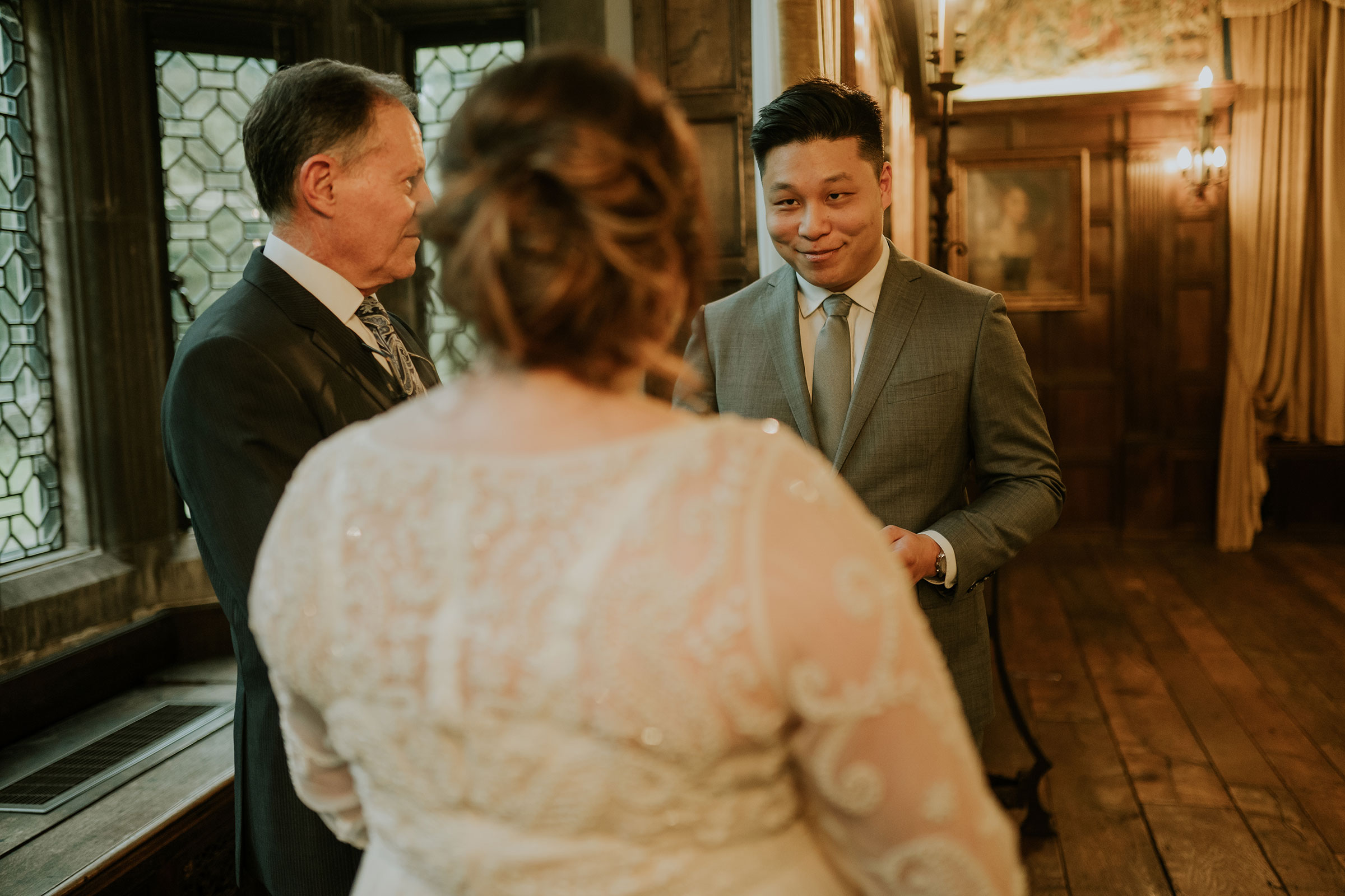 groom-looking-at-bride-during-vows-elopement-salisbury-house-desmoines-iowa-raelyn-ramey-photography.jpg