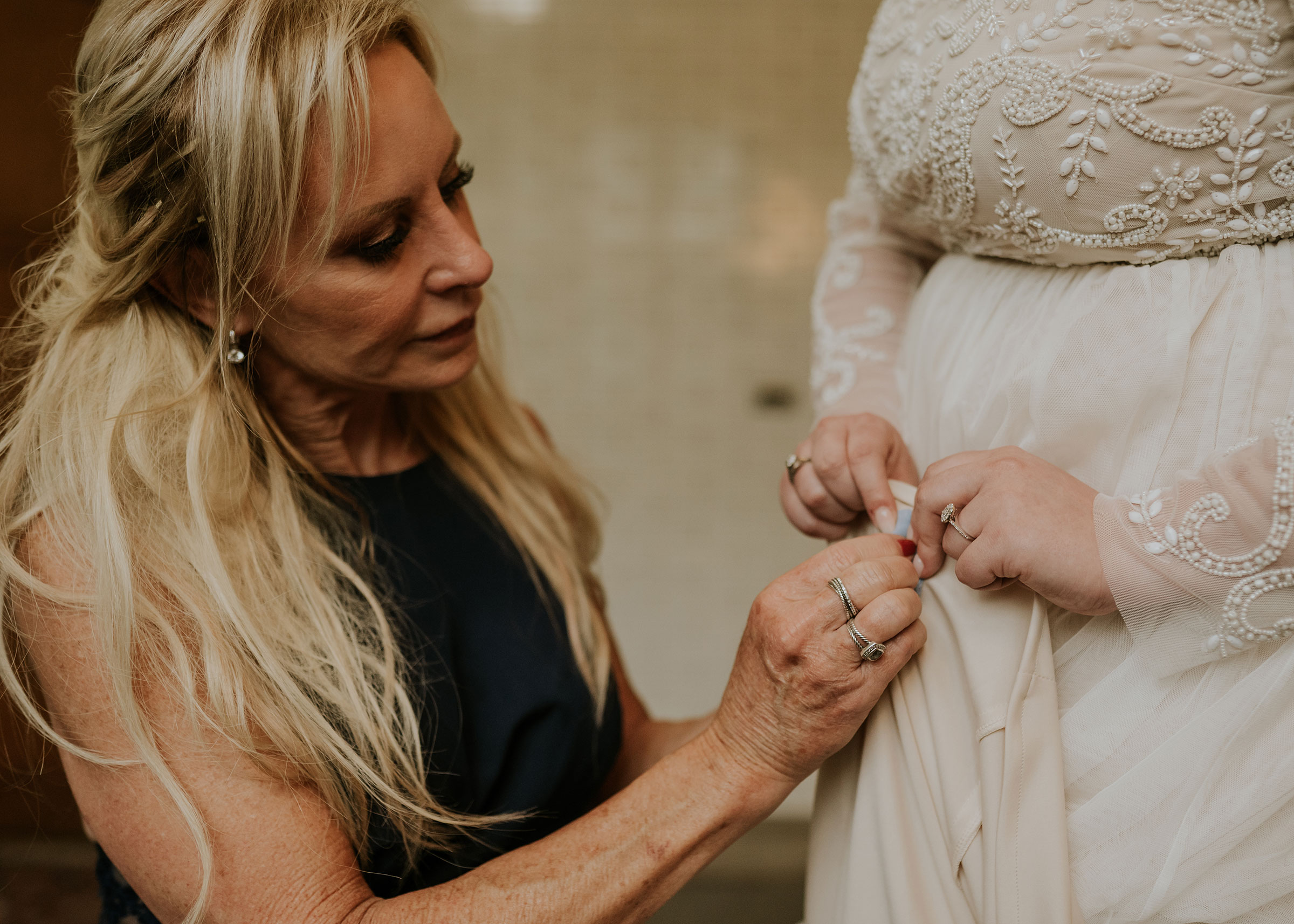 mother-pinning-grnadfathers-fabric-to-brides-dress-elopement-salisbury-house-desmoines-iowa-raelyn-ramey-photography.jpg