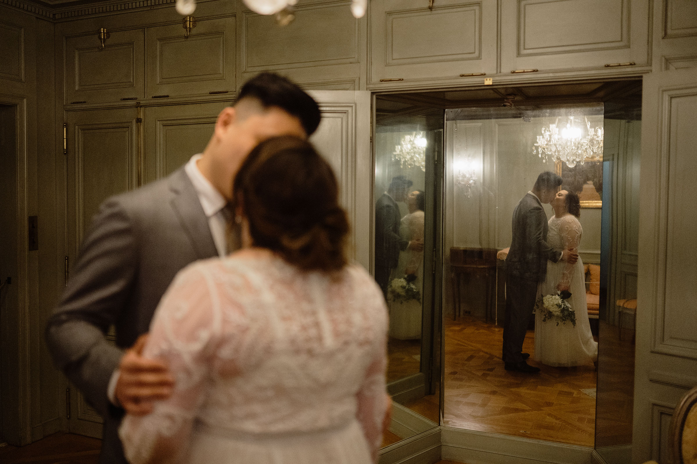 bride-and-groom-kissing-with-mirrors-around-elopement-salisbury-house-desmoines-iowa-raelyn-ramey-photography.jpg