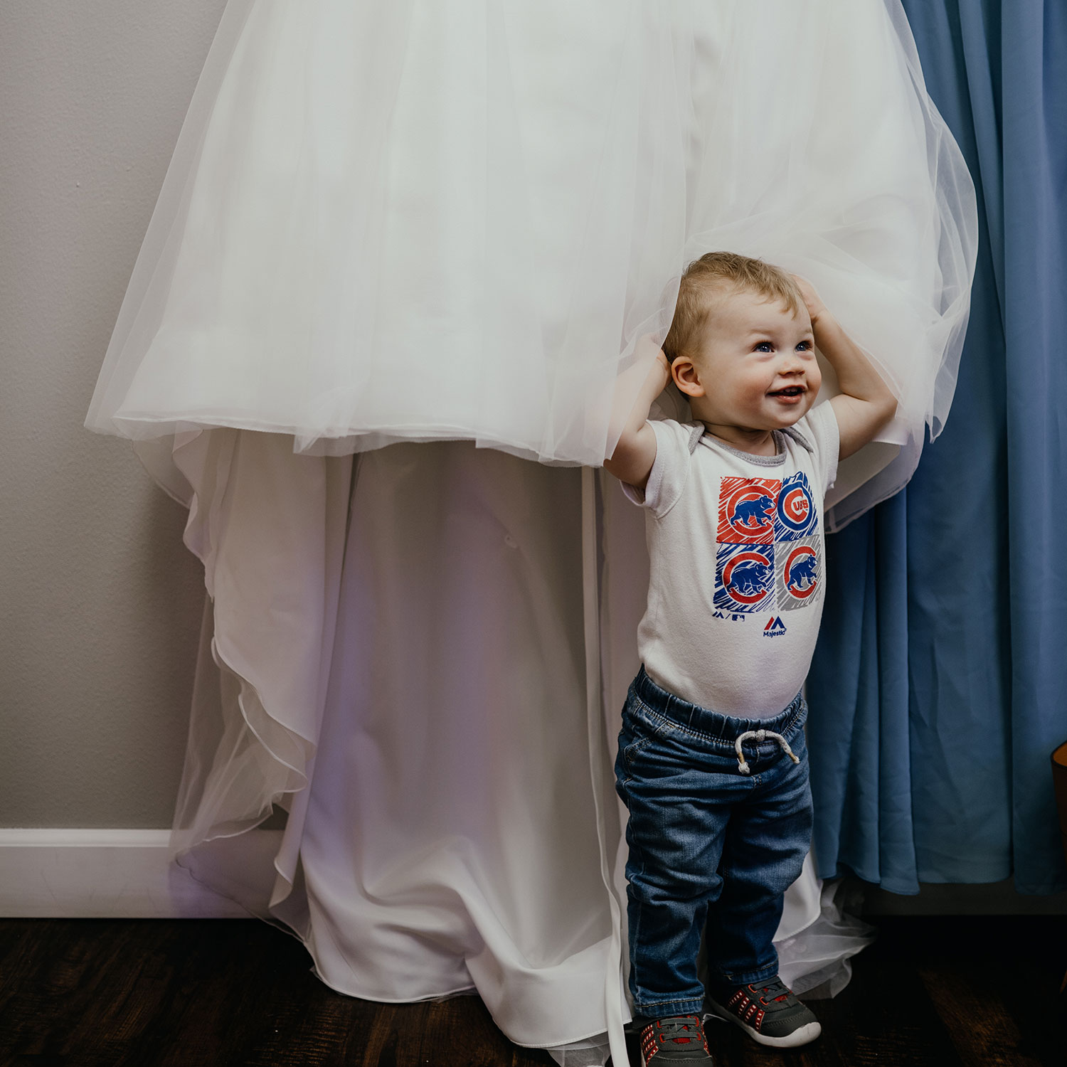 baby-boy-hiding-in-dress-wedding-decades-event-center-moines-iowa-raelyn-ramey-photography-9.jpg