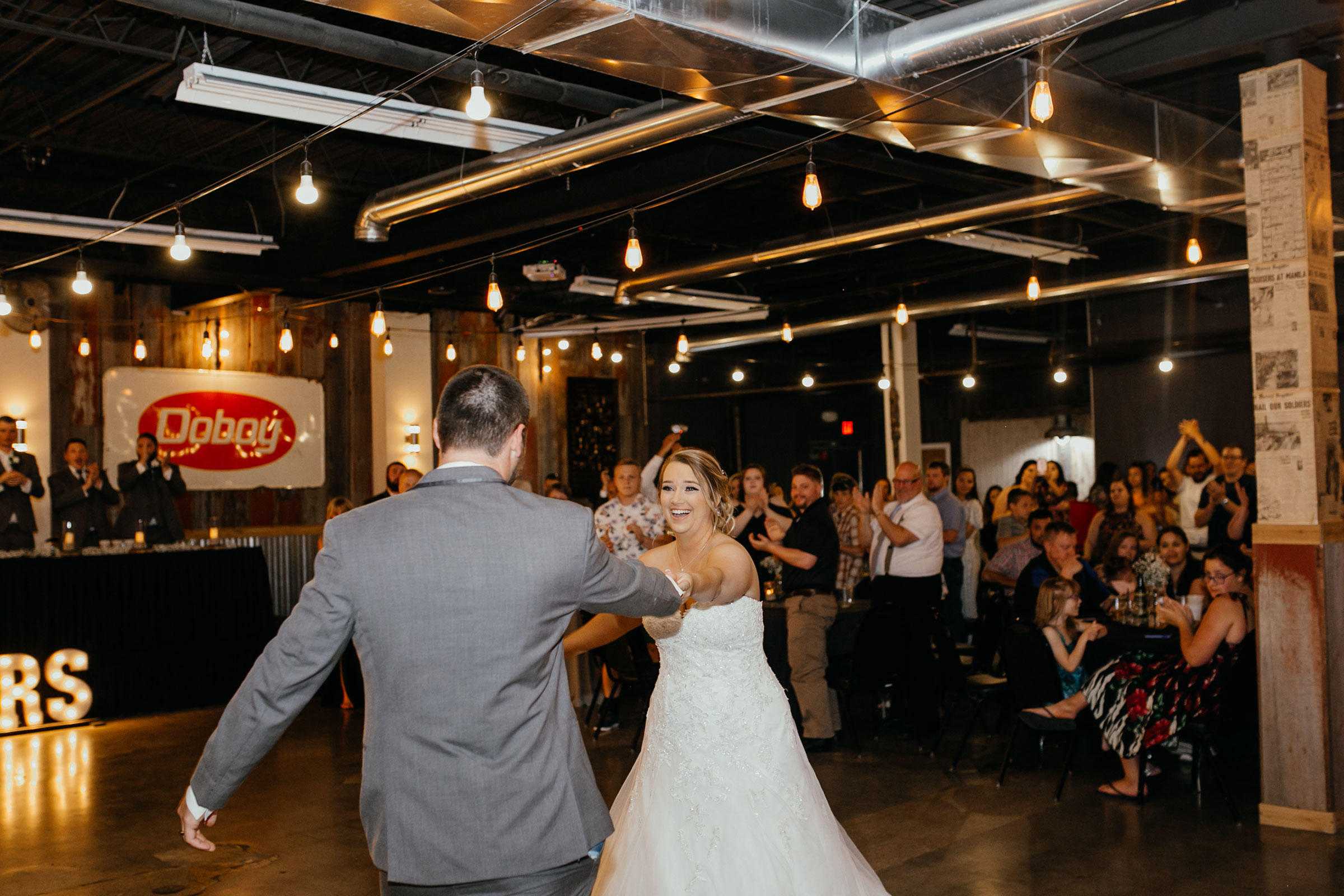 bride-and-groom-enterance-decades-event-center-building-desmoines-iowa-raelyn-ramey-photography..jpg