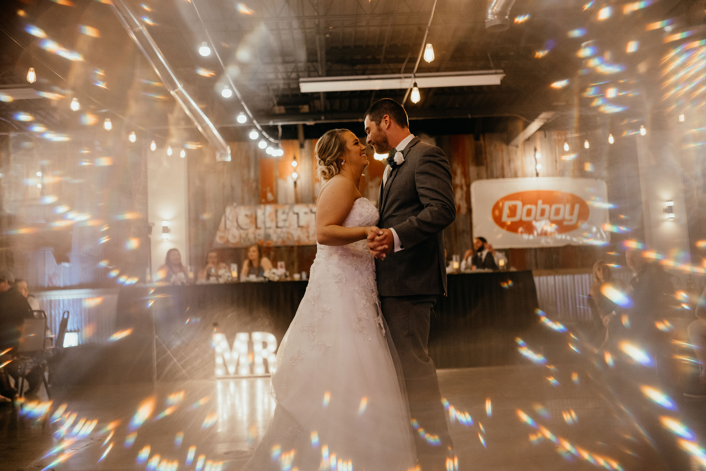 bride-dancing-with-groom-decades-event-center-building-desmoines-iowa-raelyn-ramey-photography..jpg