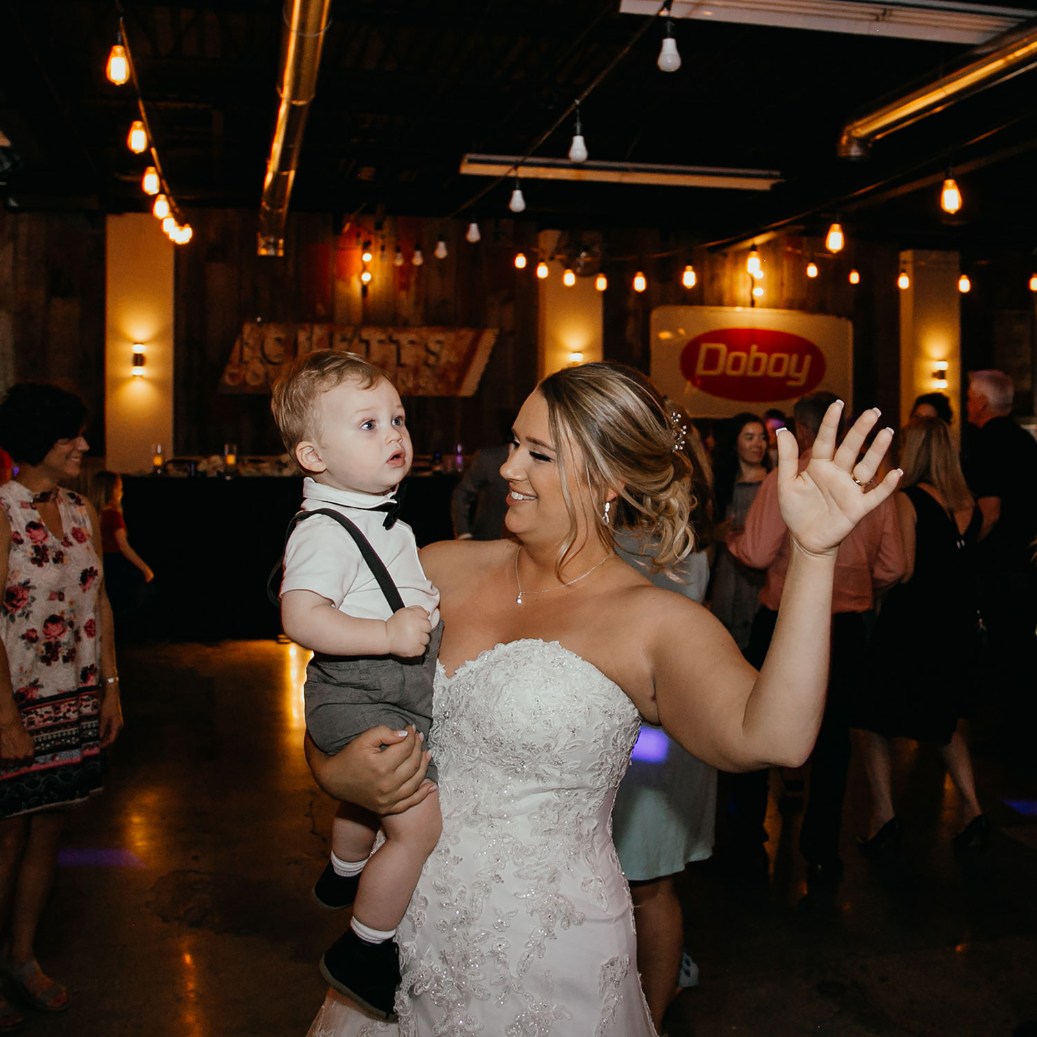 bride-dancing-with-son-decades-event-center-building-desmoines-iowa-raelyn-ramey-photography..jpg