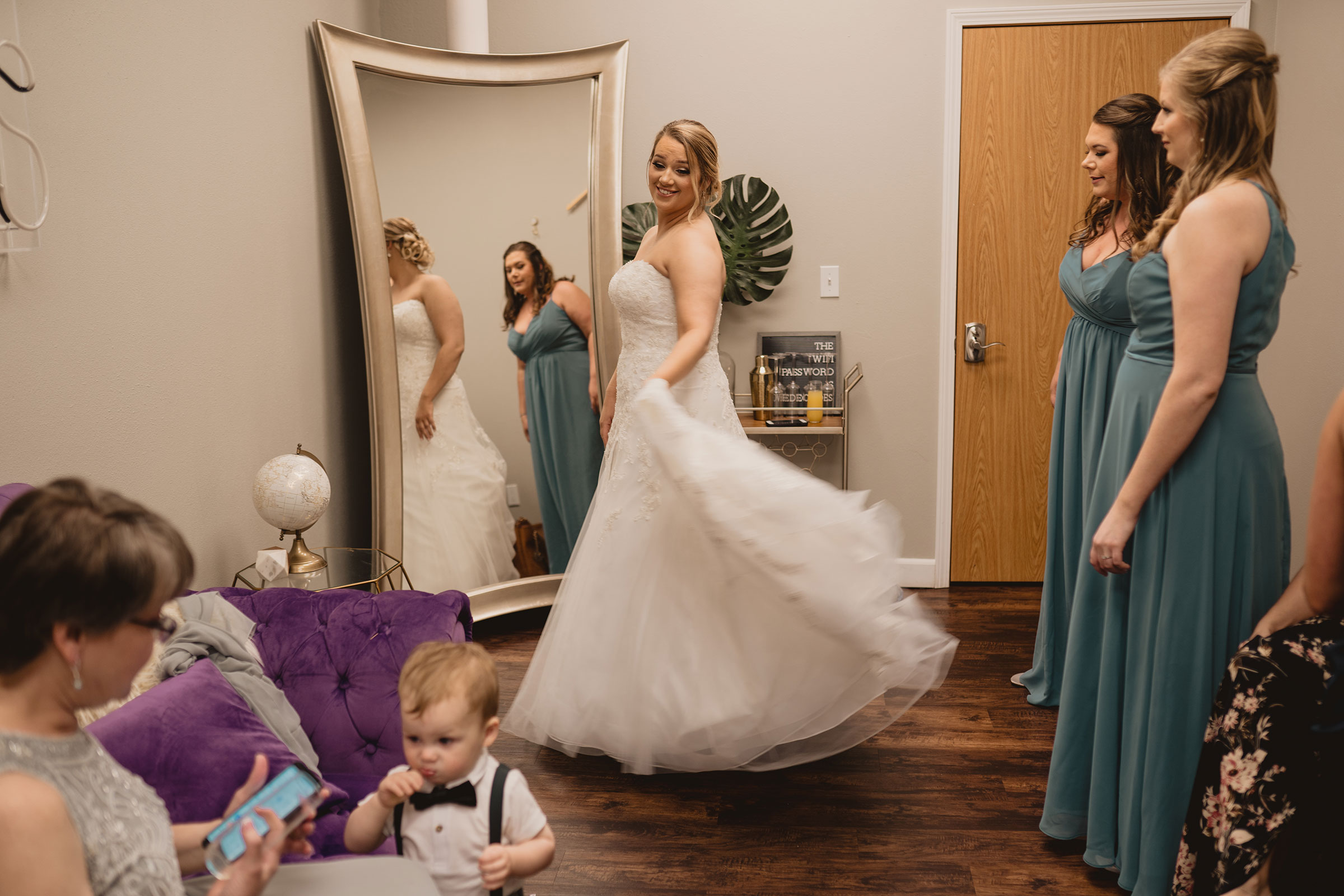 bride-swirling-her-dress-while-getting-ready-decades-event-center-building-desmoines-iowa-raelyn-ramey-photography..jpg