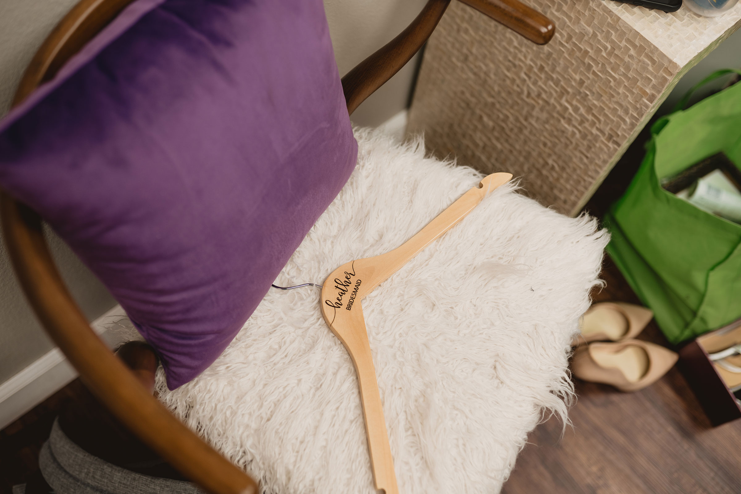 bridesmaid-hanger-with-name-decades-event-center-building-desmoines-iowa-raelyn-ramey-photography..jpg