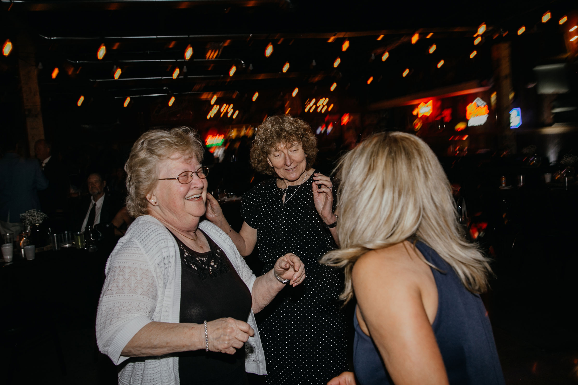 grandma-dancing-with-mom-decades-event-center-building-desmoines-iowa-raelyn-ramey-photography..jpg