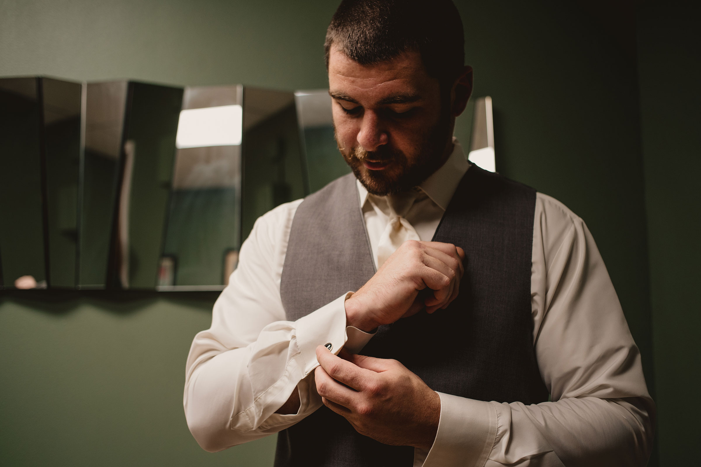 groom-getting-ready-decades-event-center-building-desmoines-iowa-raelyn-ramey-photography..jpg