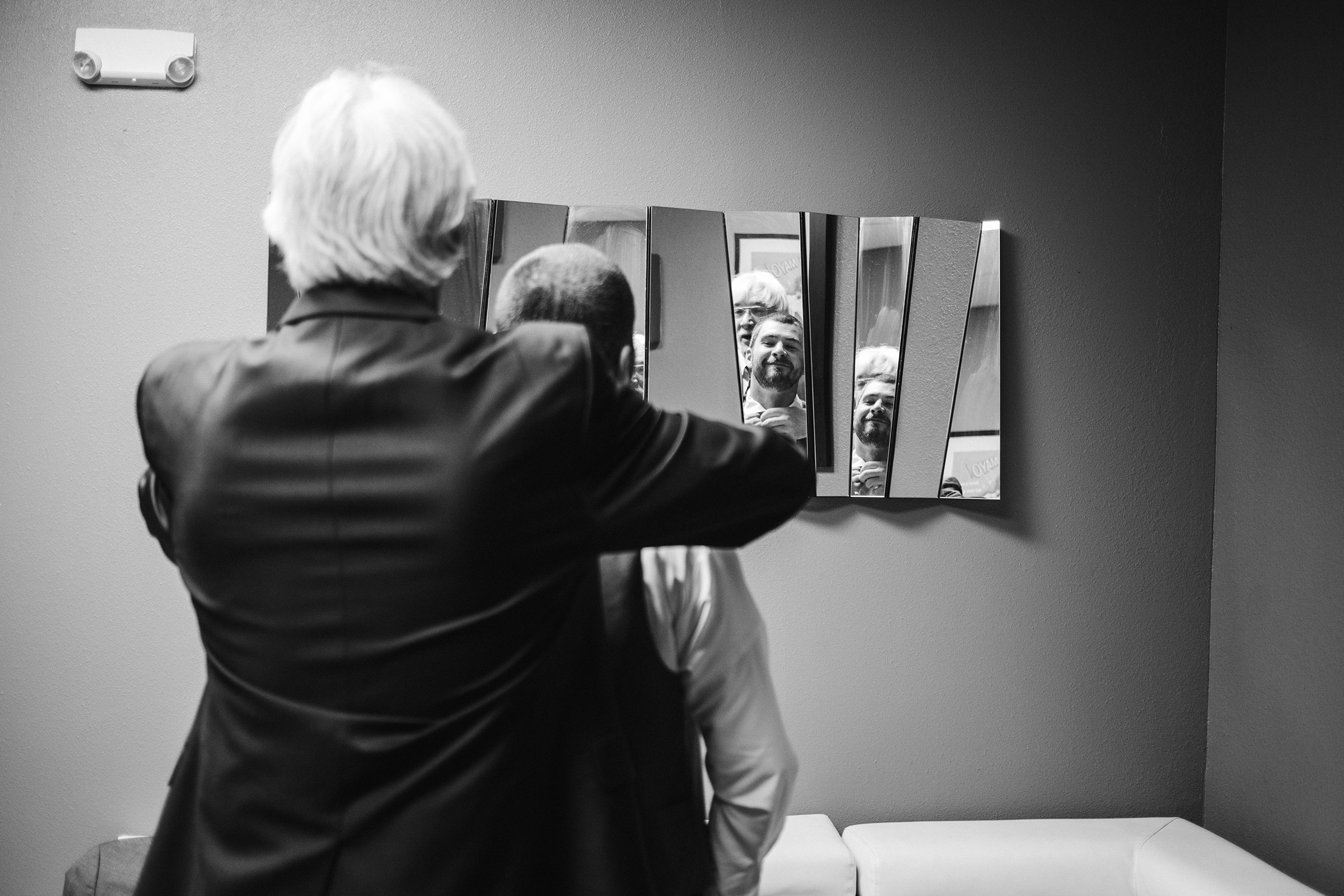 groom-father-helping-him-get-ready-decades-event-center-building-desmoines-iowa-raelyn-ramey-photography..jpg