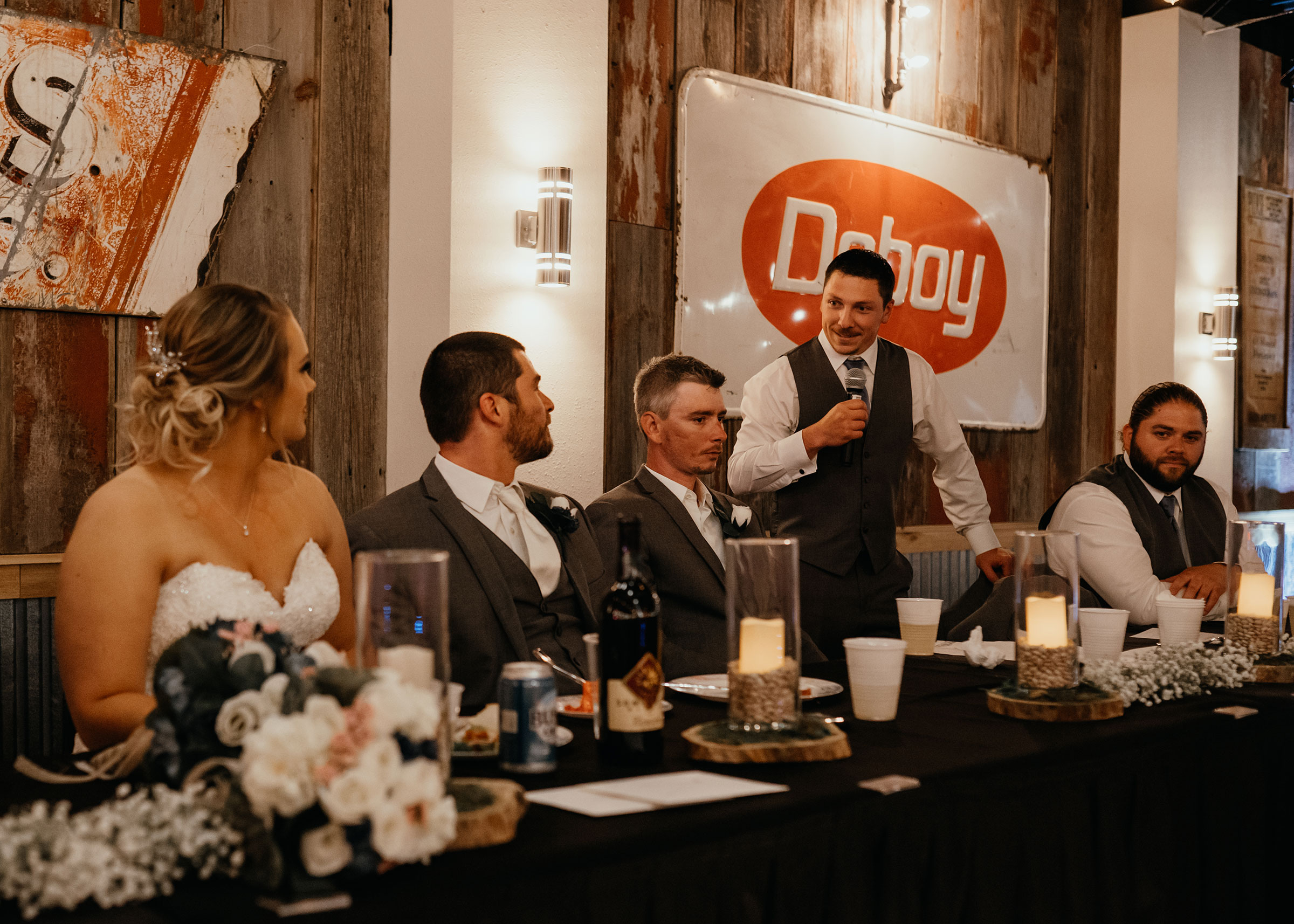 groomsmen-giving-speech-decades-event-center-building-desmoines-iowa-raelyn-ramey-photography..jpg