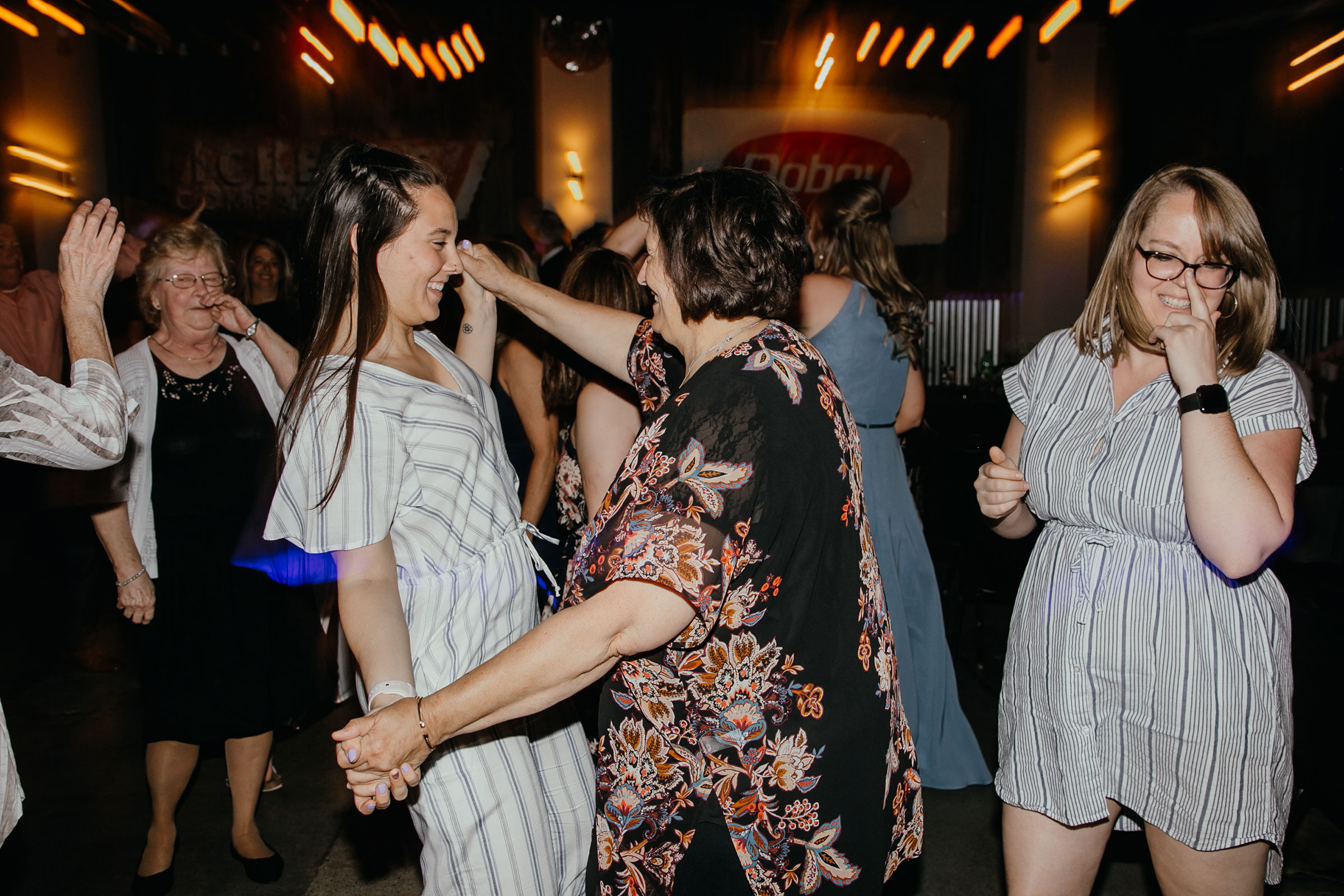 guest-dancing-with-grandma-decades-event-center-building-desmoines-iowa-raelyn-ramey-photography..jpg