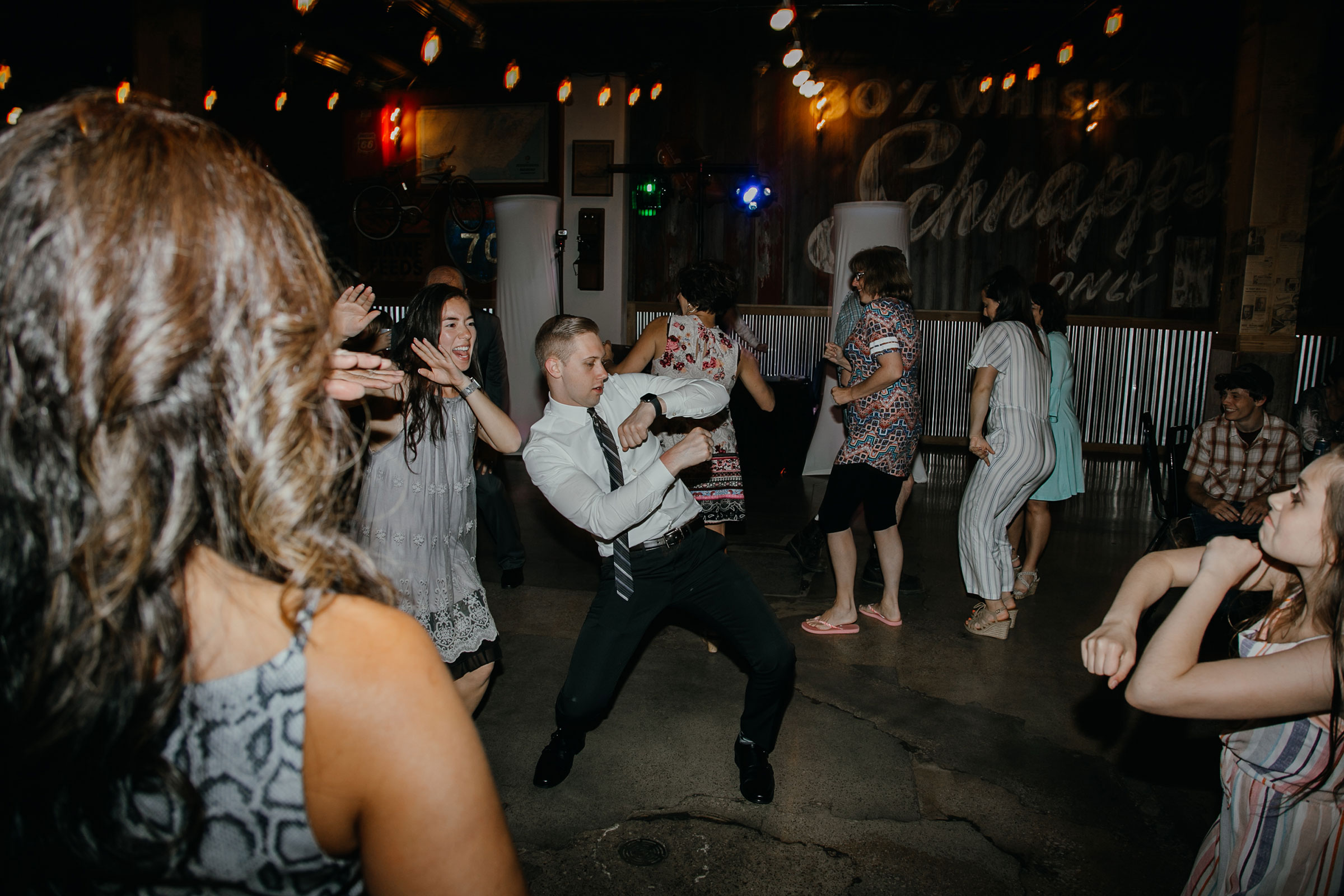 guests-dancing-on-dance-floor-at-reception-decades-event-center-building-desmoines-iowa-raelyn-ramey-photography..jpg