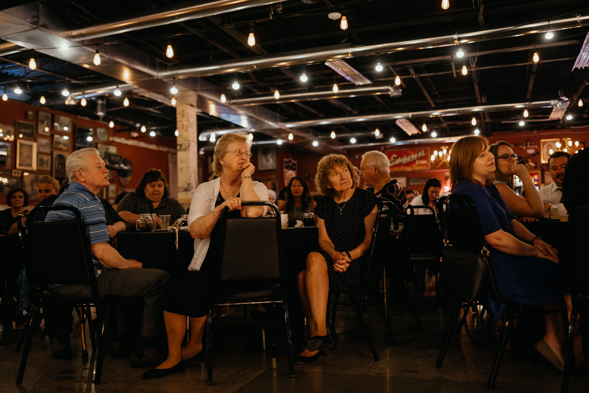 guests-watching-speeches-decades-event-center-building-desmoines-iowa-raelyn-ramey-photography..jpg