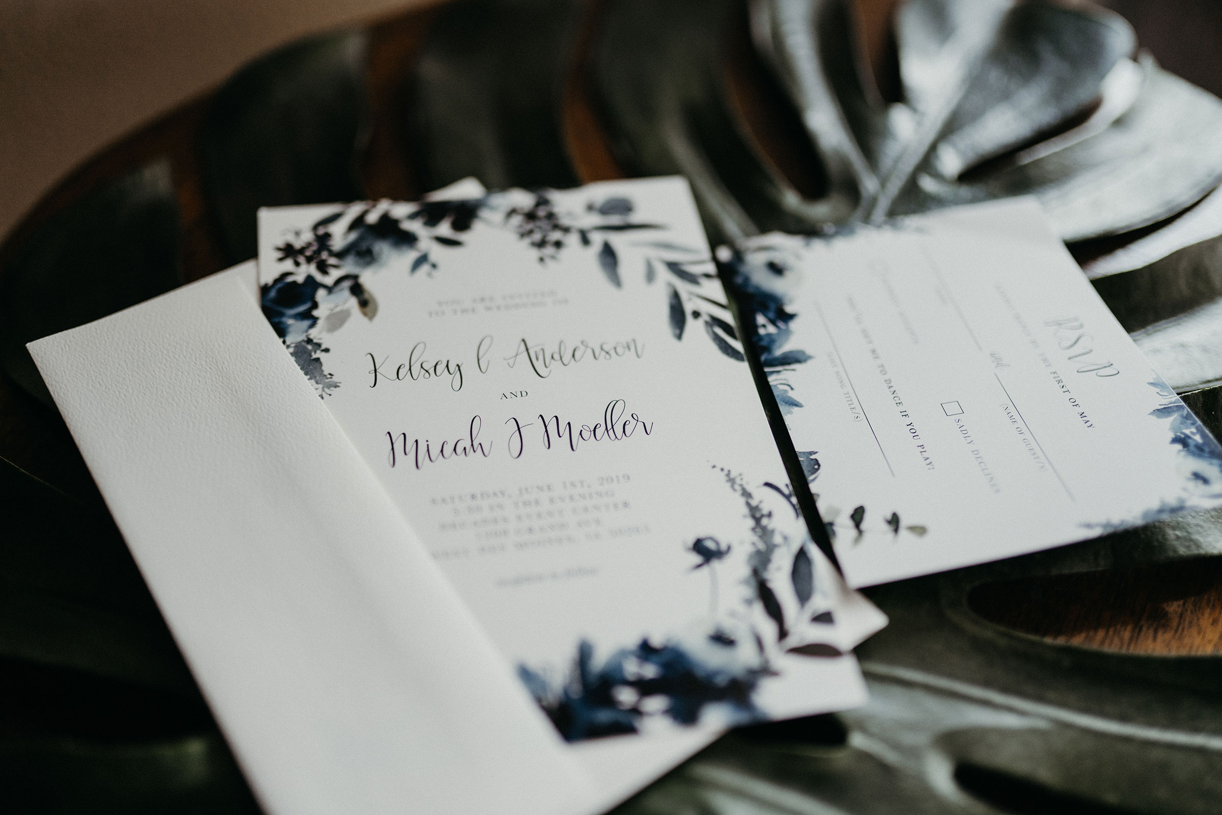 invites-laying-on-end-table-decades-event-center-building-desmoines-iowa-raelyn-ramey-photography..jpg