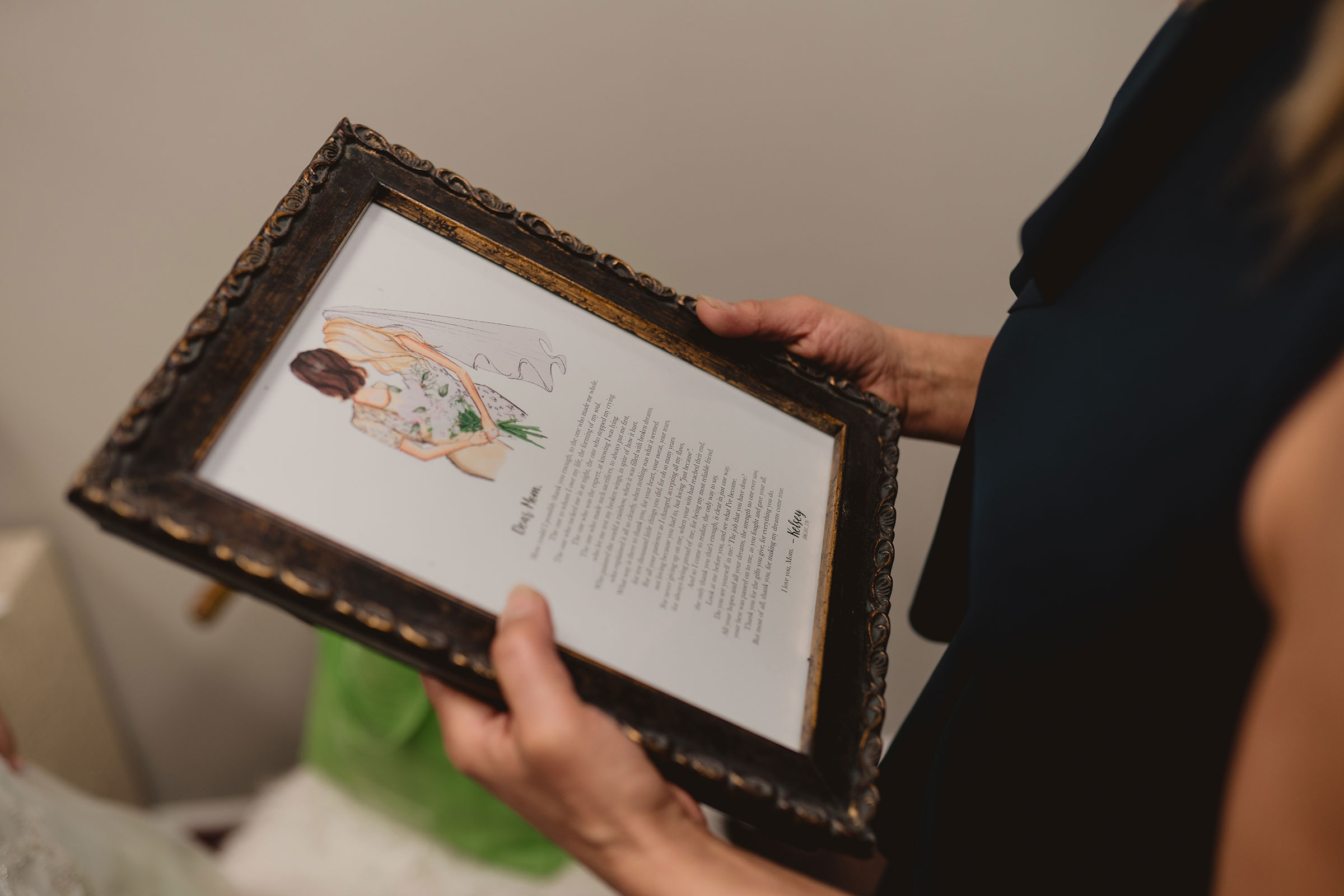 mother-of-bride-reading-gift-decades-event-center-building-desmoines-iowa-raelyn-ramey-photography..jpg