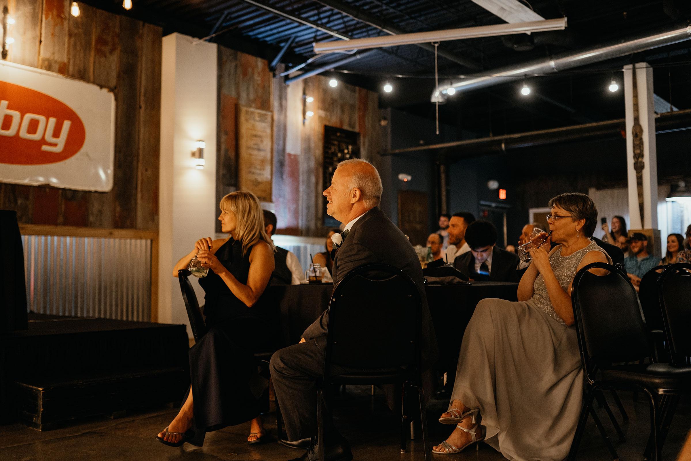 parents-listening-to-speeches-decades-event-center-building-desmoines-iowa-raelyn-ramey-photography..jpg