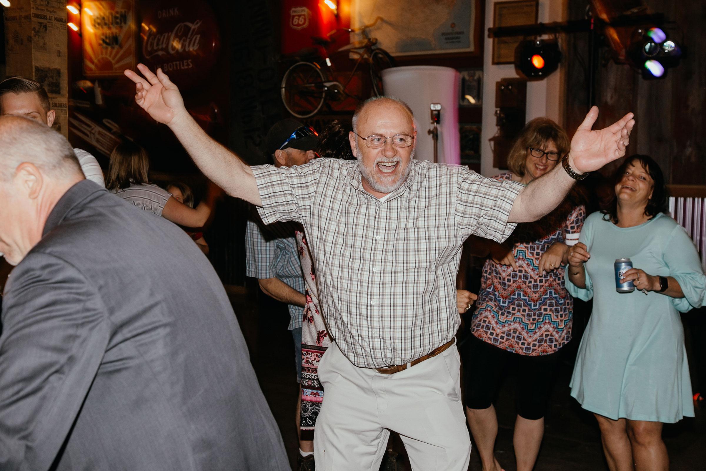 person-dancing-on-floor-decades-event-center-building-desmoines-iowa-raelyn-ramey-photography..jpg