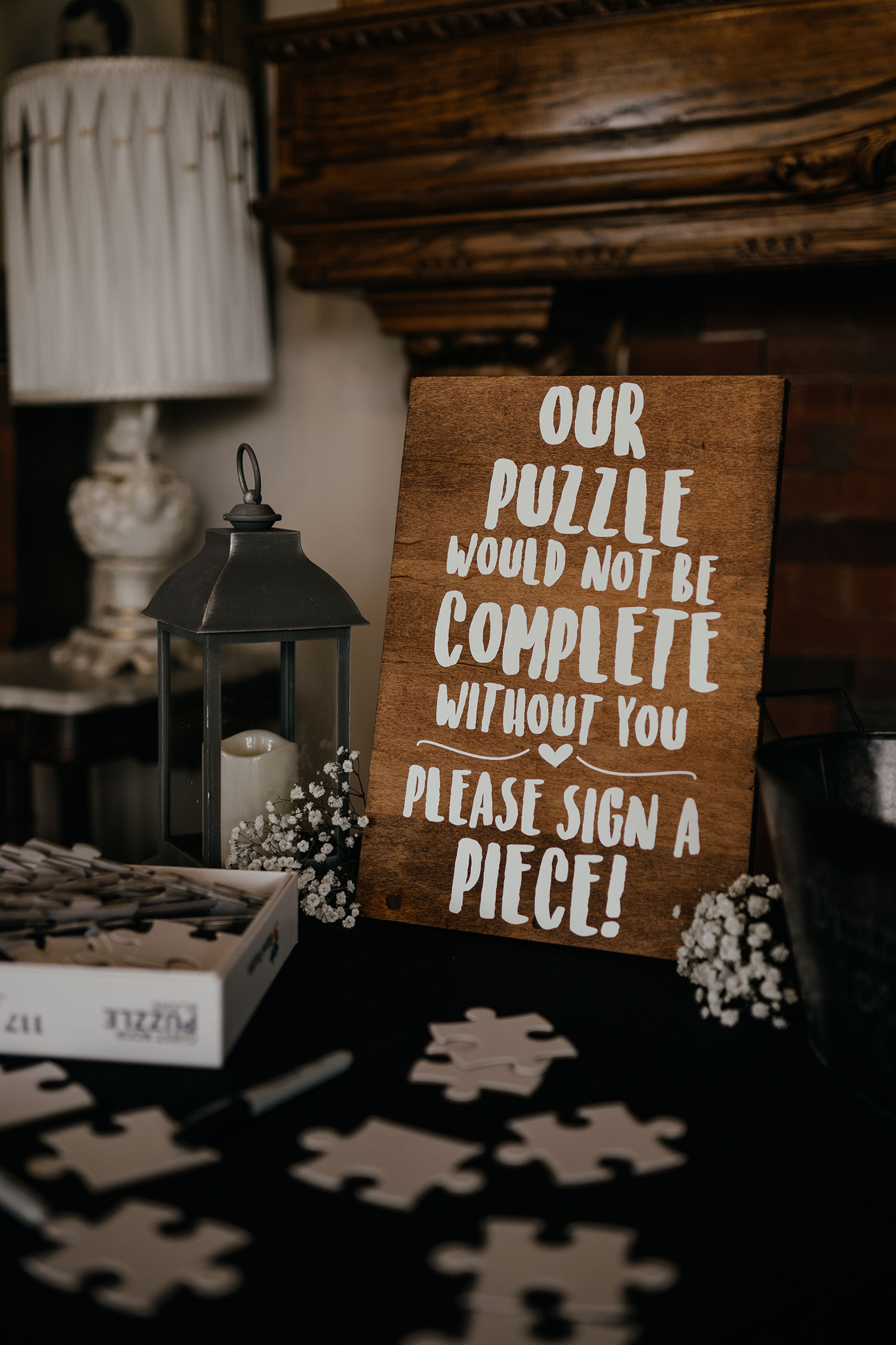 welcome-table-sign-in-puzzle-pieces-decades-event-center-building-desmoines-iowa-raelyn-ramey-photography..jpg