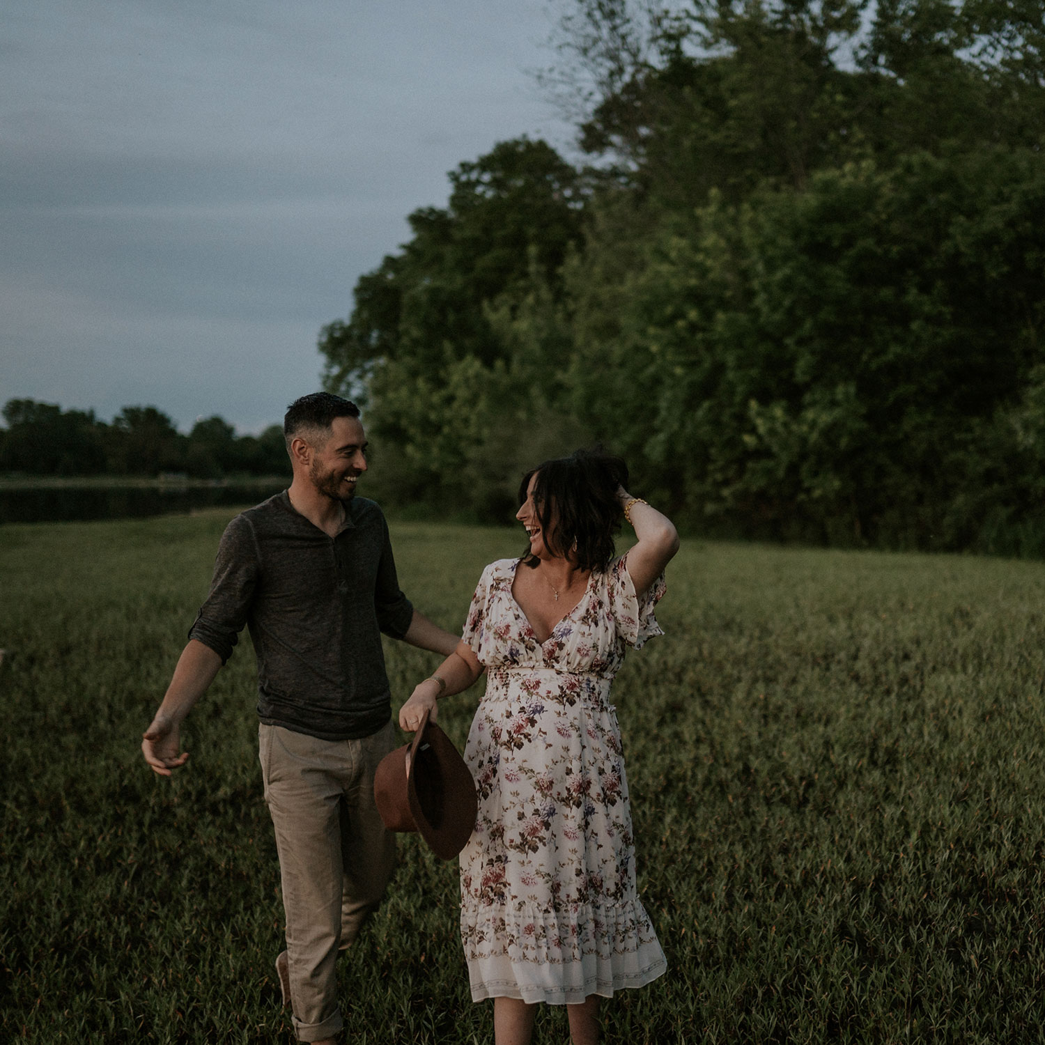 mom-to-be-and-husband-walking-and-laughing-maternity-desmoines-iowa-raelyn-ramey-photography.jpg