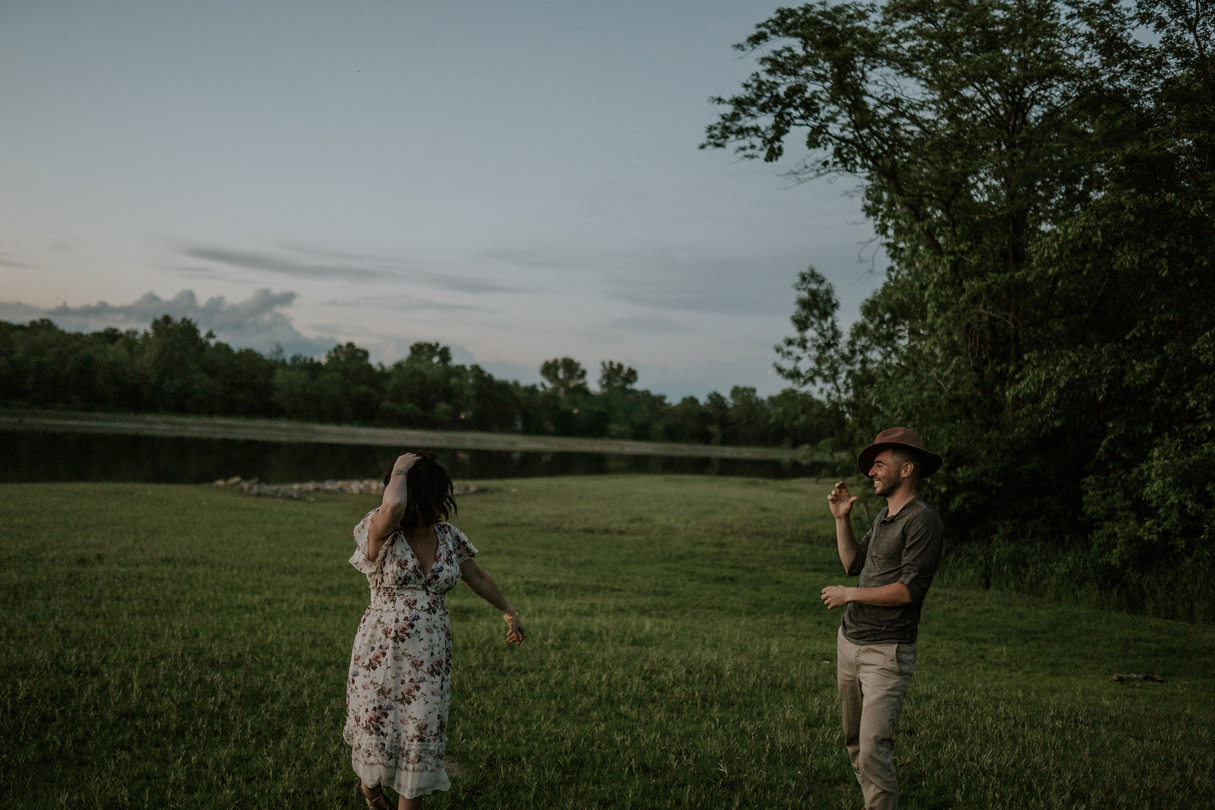 mom-to-be-walking-with-husband-laughing-playing-with-hat-desmoines-iowa-raelyn-ramey-photography.jpg