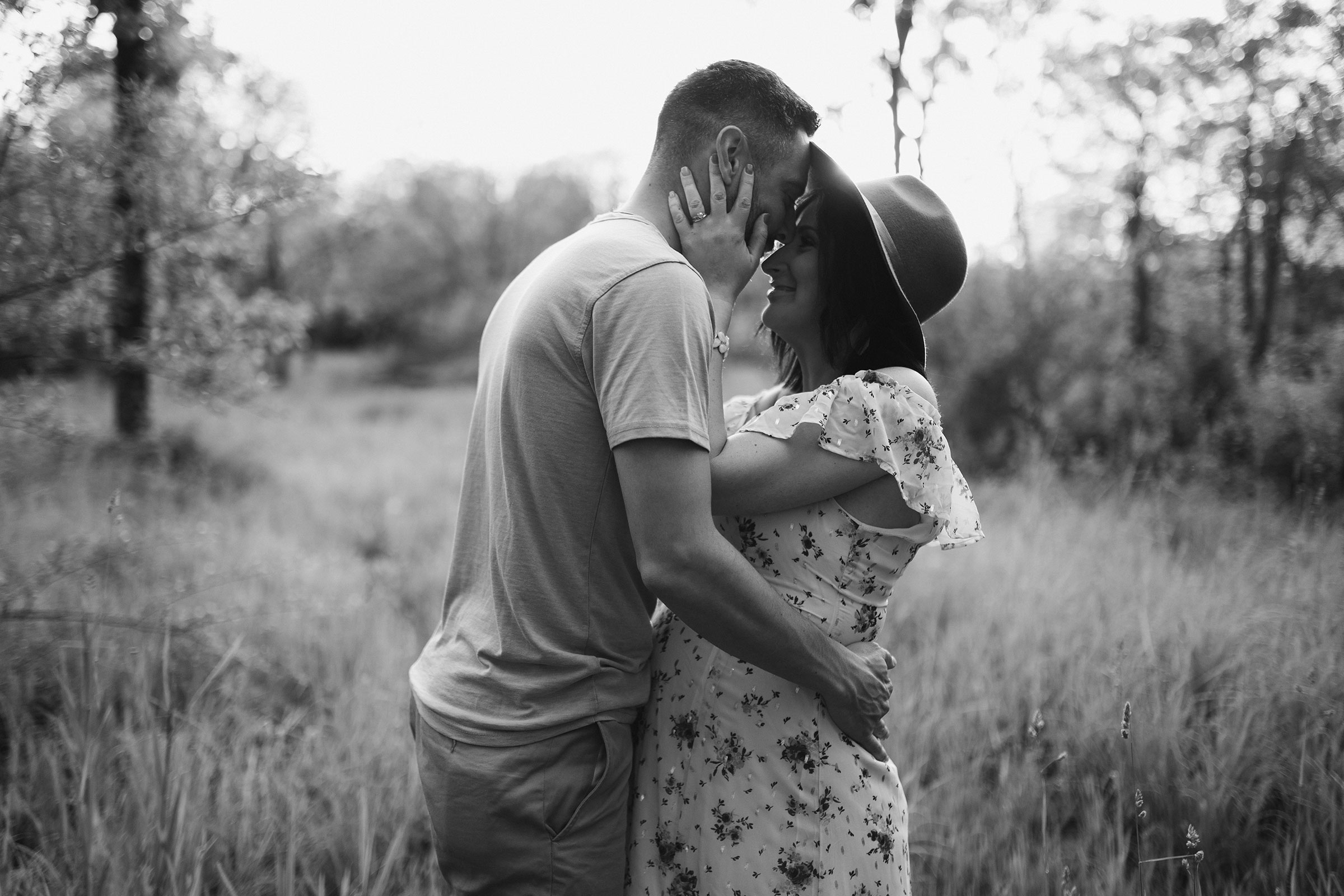 pregnant-couple-holding-each-other-intensley-maternity-desmoines-iowa-raelyn-ramey-photography.jpg