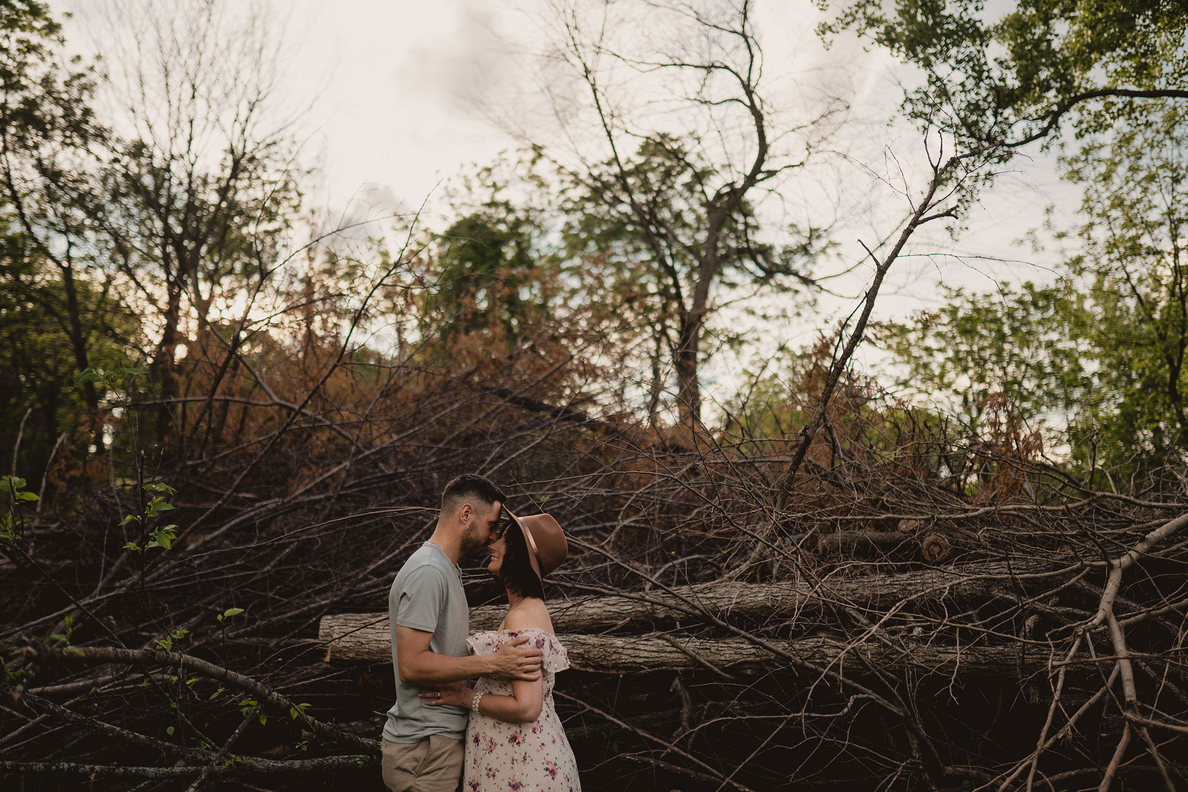 pregnant-couple-holding-each-other-almost-kissing-maternity-desmoines-iowa-raelyn-ramey-photography.jpg