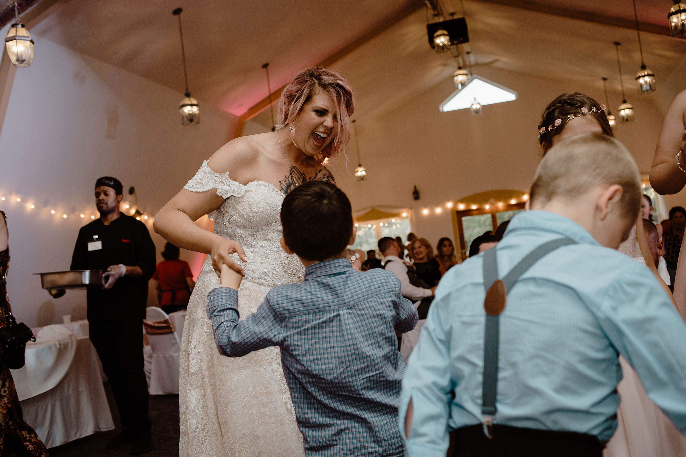 bride-dancing-with-a-child-summerset-winery-indianola-iowa-raelyn-ramey-photography.jpg