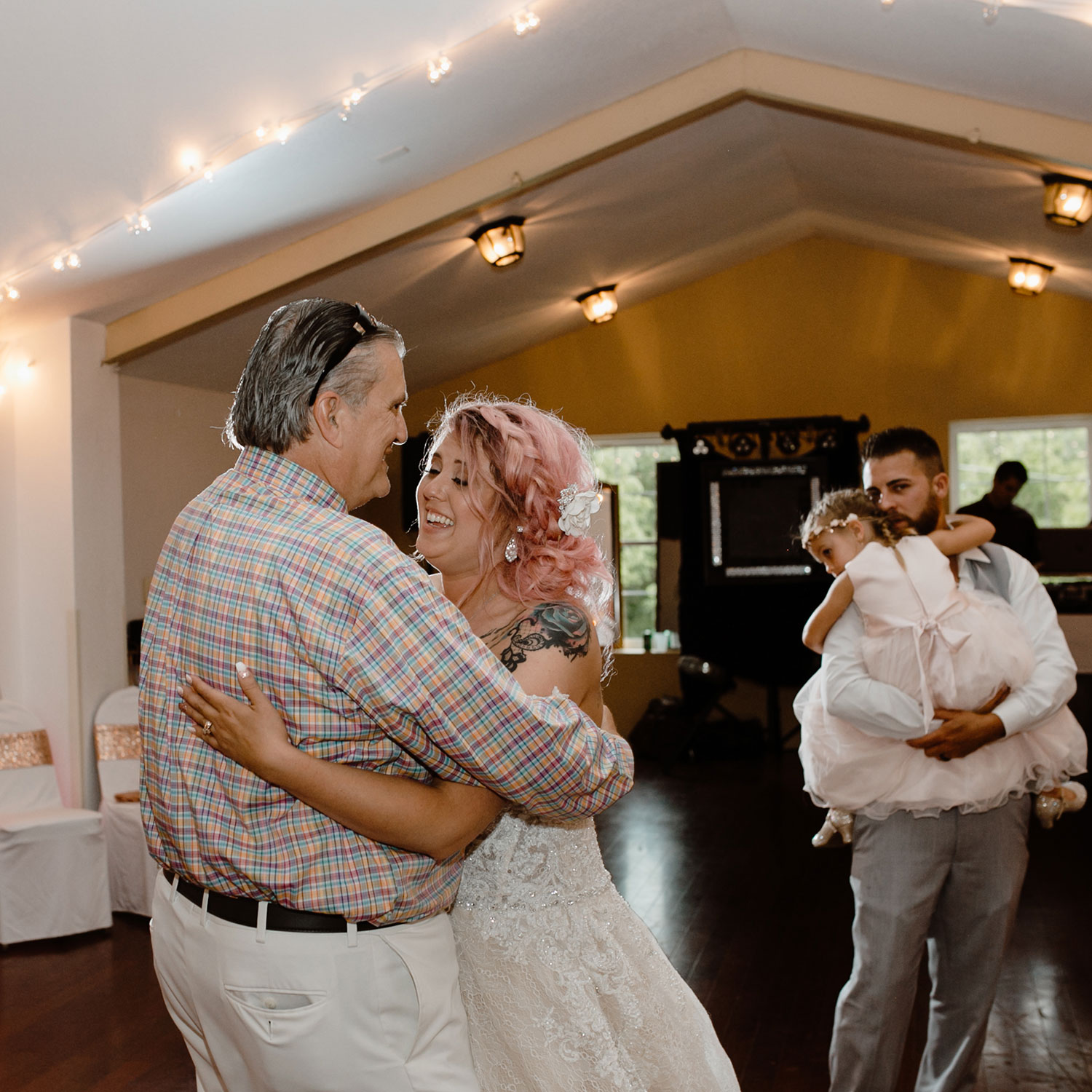 bride-dancing-with-step-father-smiling-wedding-summerset-winery-indianola-iowa-raelyn-ramey-photography.jpg