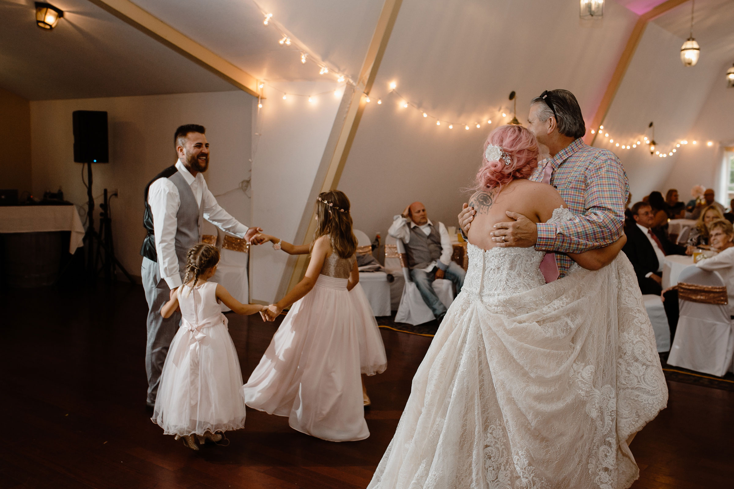 bride-dancing-with-step-dad-groom-dancing-with-daughters-wedding-summerset-winery-indianola-iowa-raelyn-ramey-photography.jpg