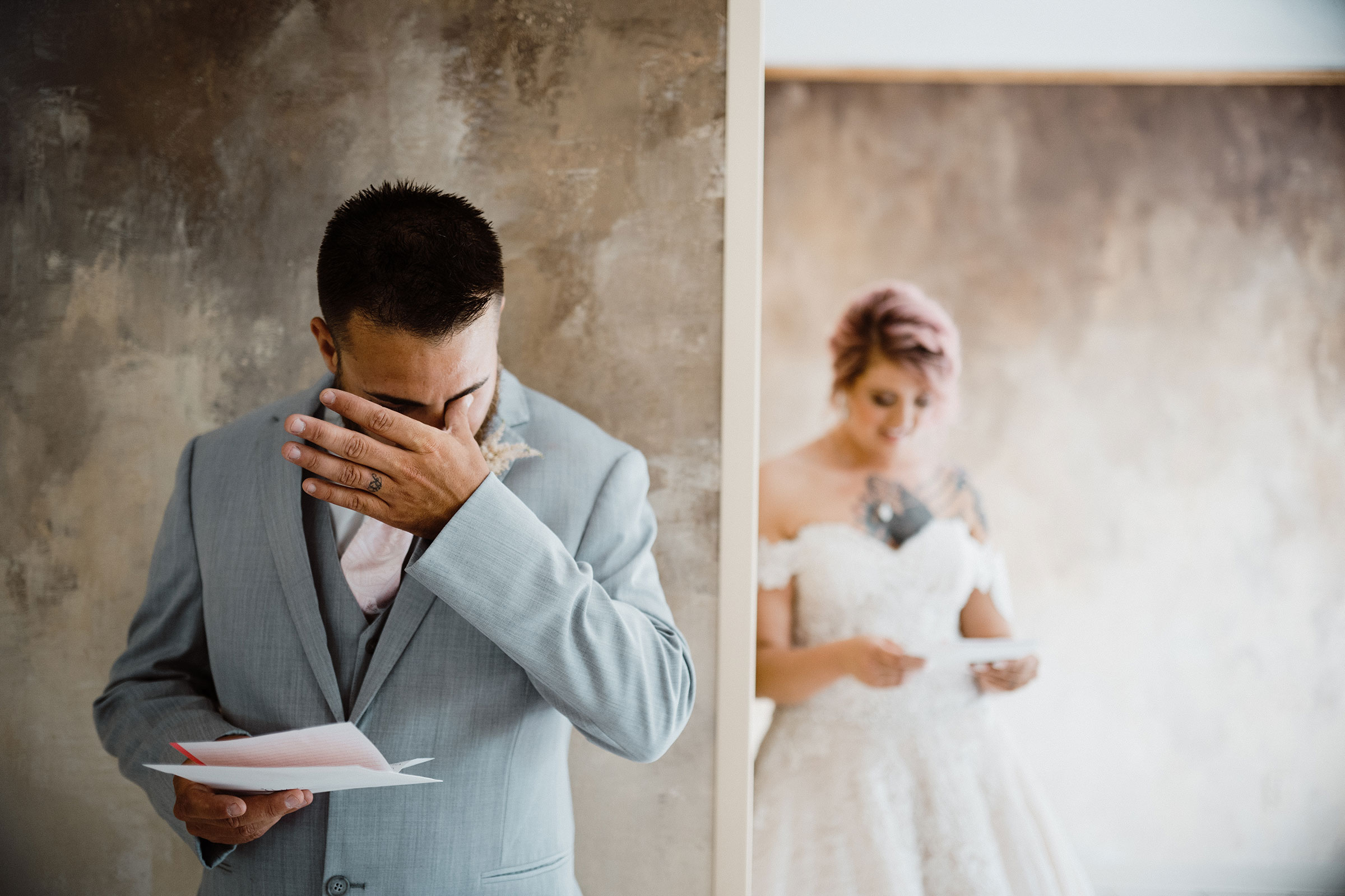 bride-groom-crying-reading-letters-wedding-summerset-winery-indianola-iowa-raelyn-ramey-photography.jpg